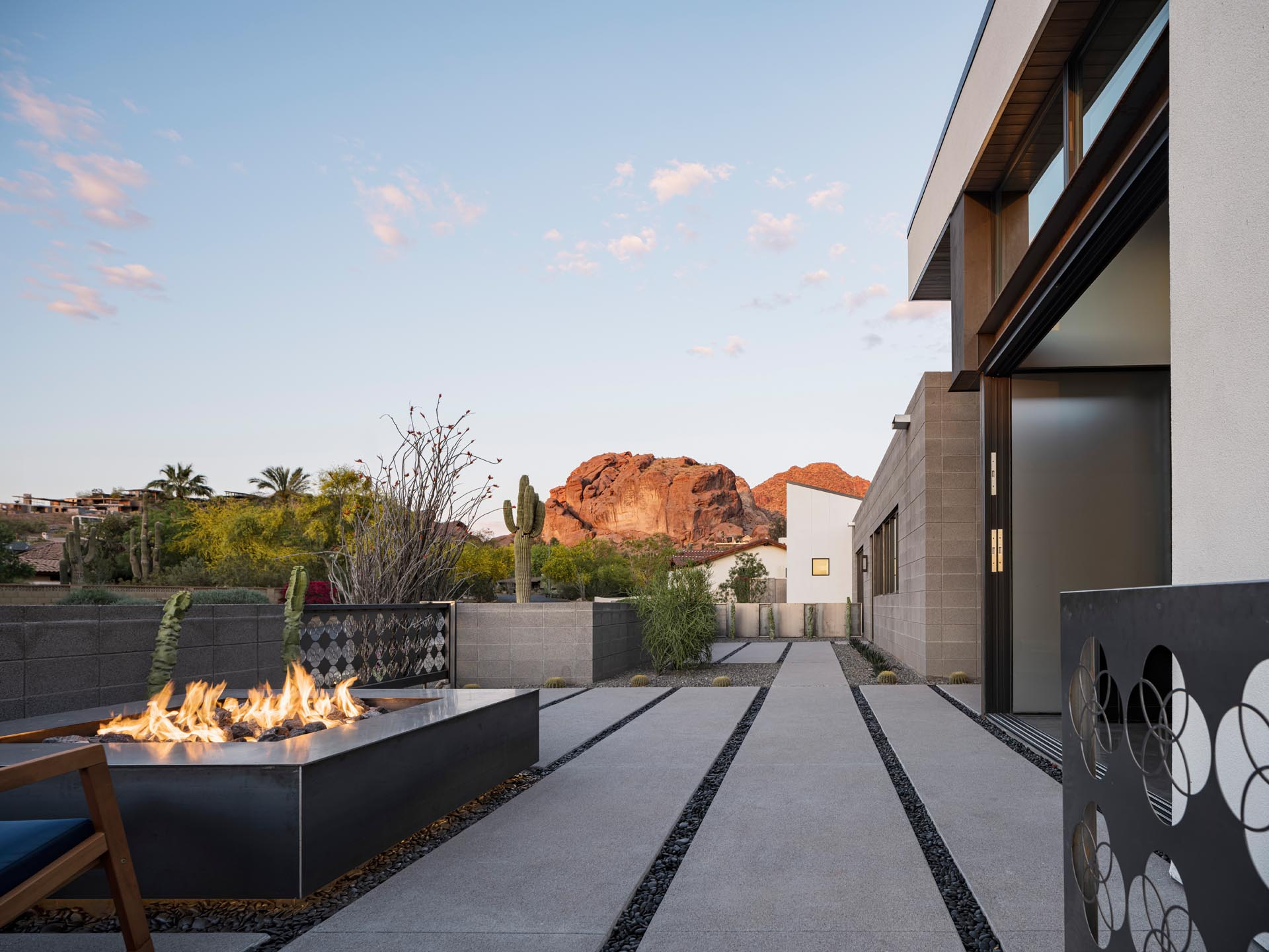 The semi-public front porch furnished with a fire pit and seating, projects out from the front of the house to take advantage of the mountain views.