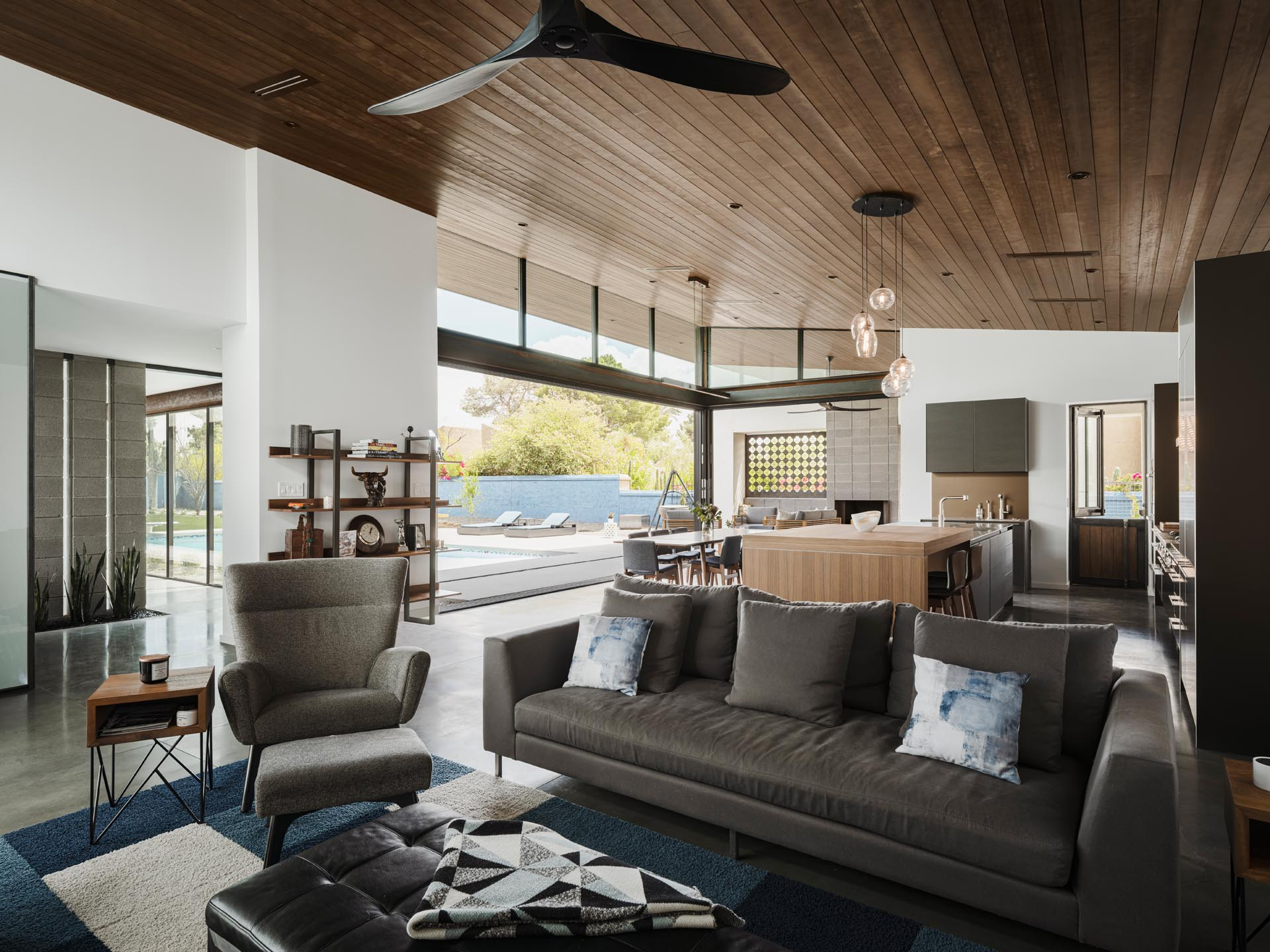 A hemlock clad ceiling spans this great room, which involves the living room, kitchen, and dining room. The ceiling is tilted upwards to take in the views.