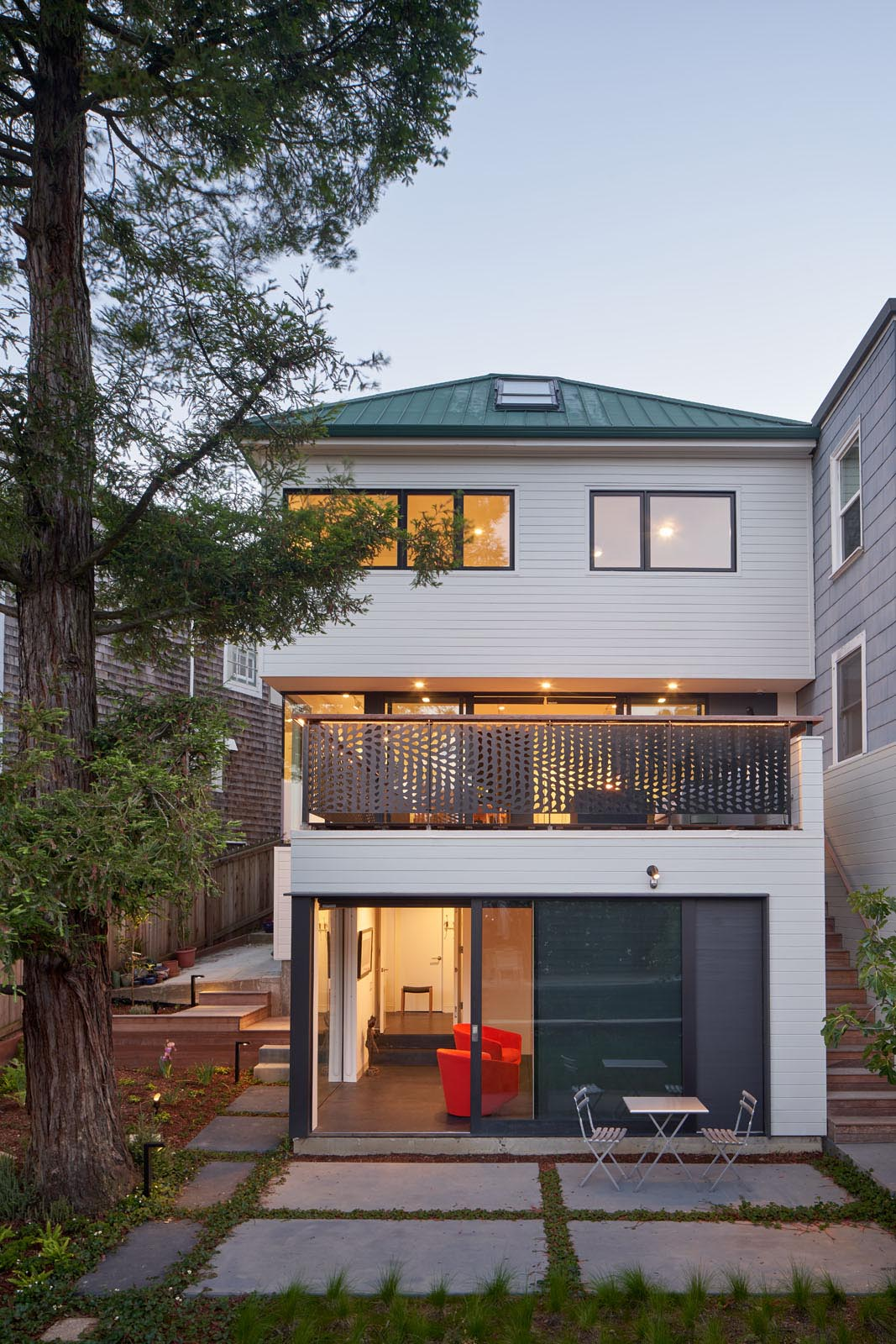 A remodeled home with a new rear deck.