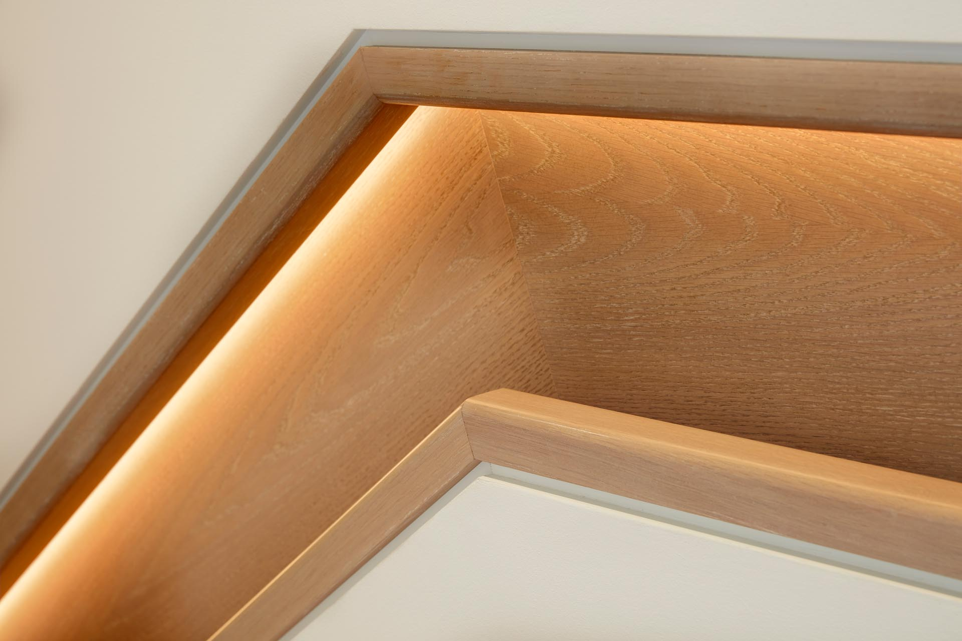 Modern wood stairs and a matching wood handrail with hidden lighting.