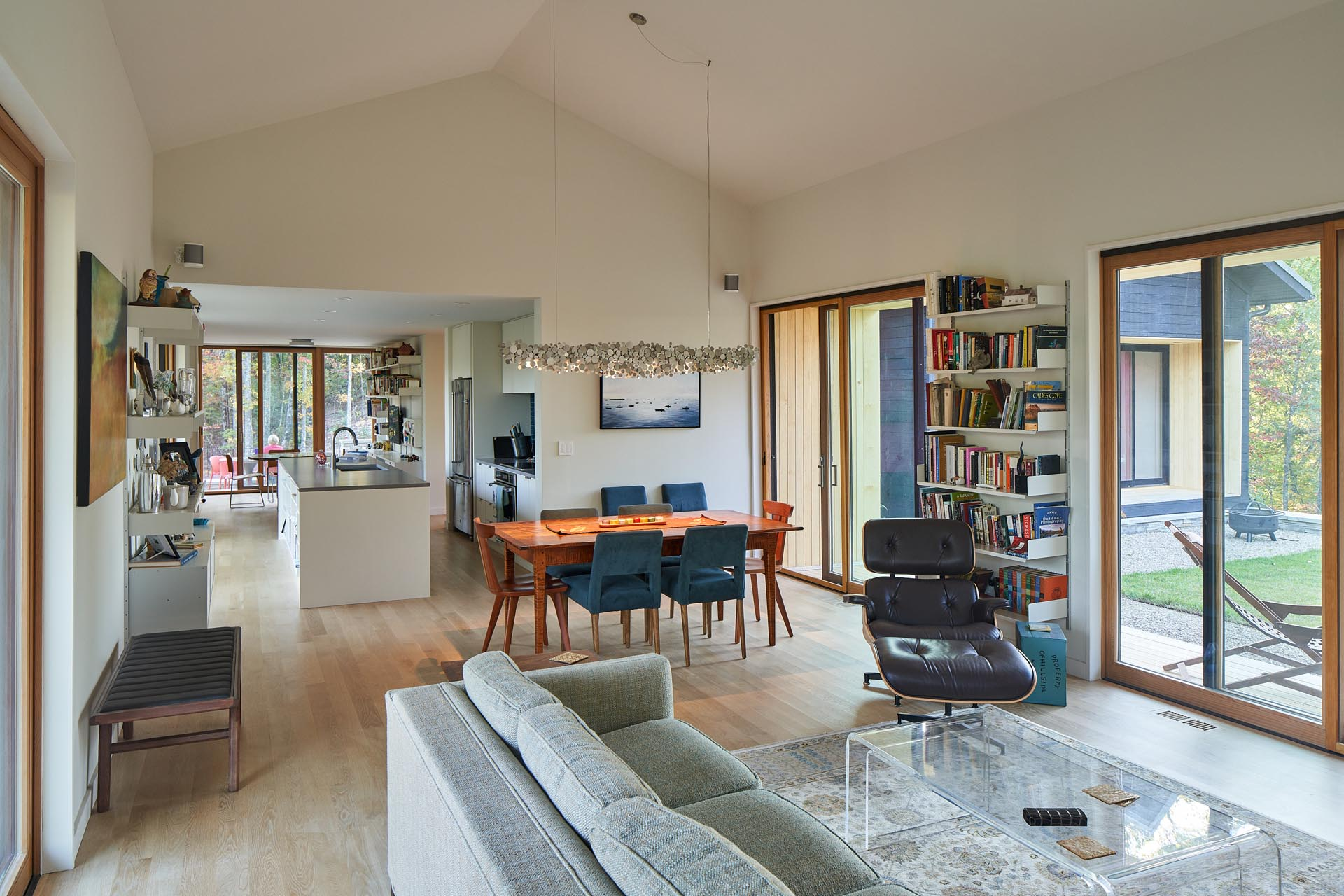An open plan living room and dining area that has a vaulted ceiling, making the space feel larger.