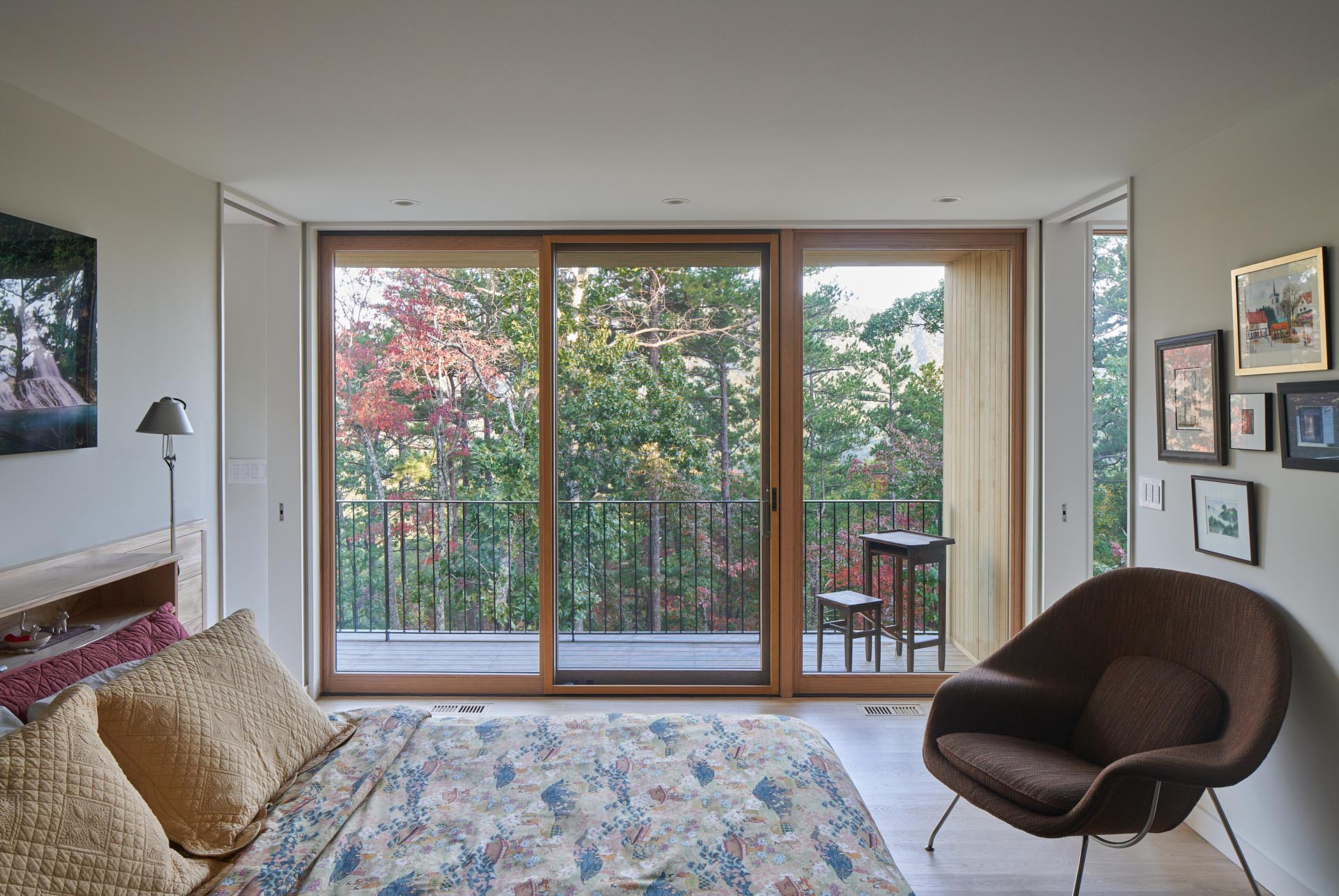 This bedroom has a sliding glass door that opens to a private outdoor space.