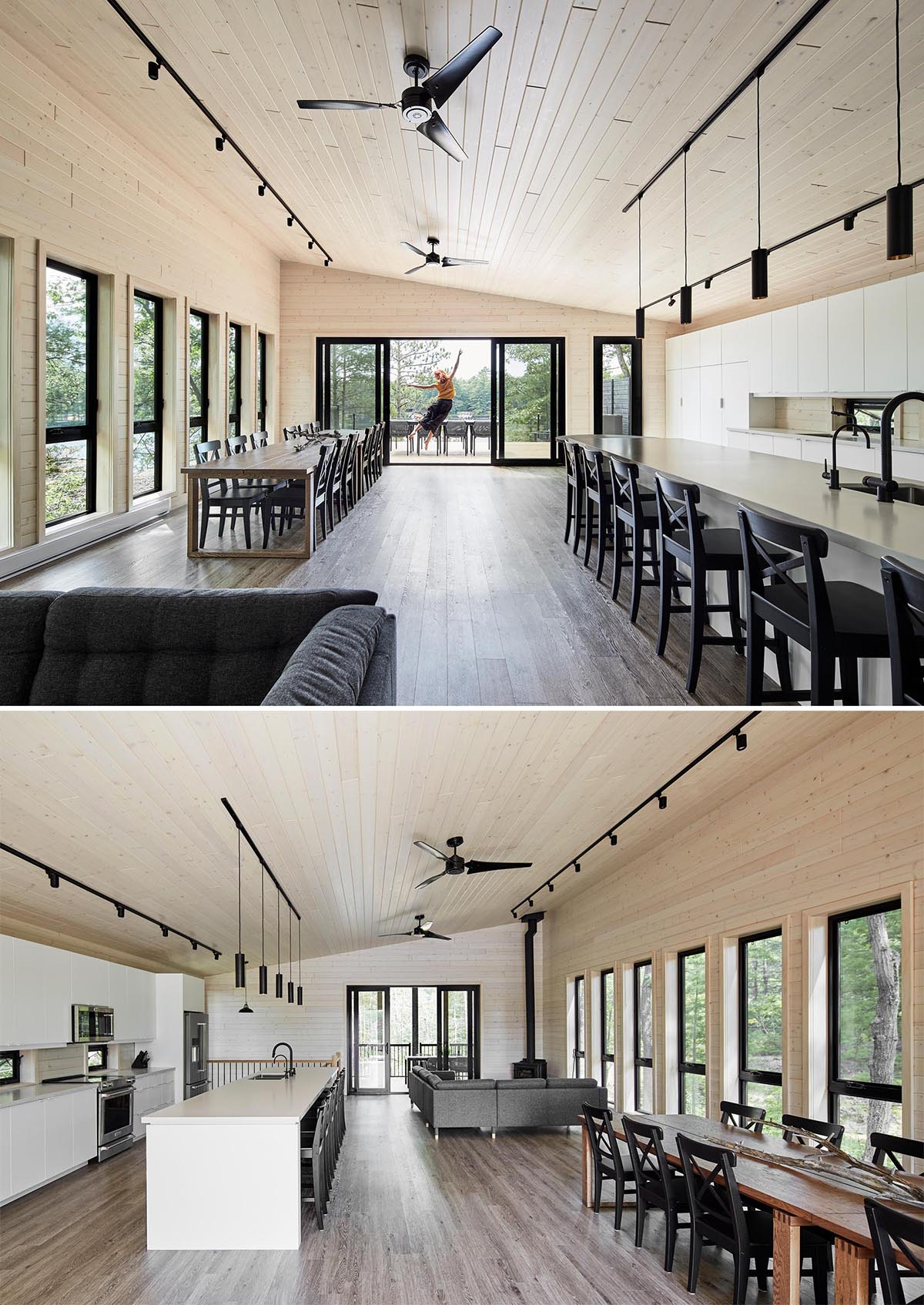 The upper floor of the home is dedicated to the living room, dining area, and kitchen. In the living room, there's an L-shaped sofa that's focused on a matte black fireplace, while the dining area has been furnished with multiple dining tables, ideal for large groups.