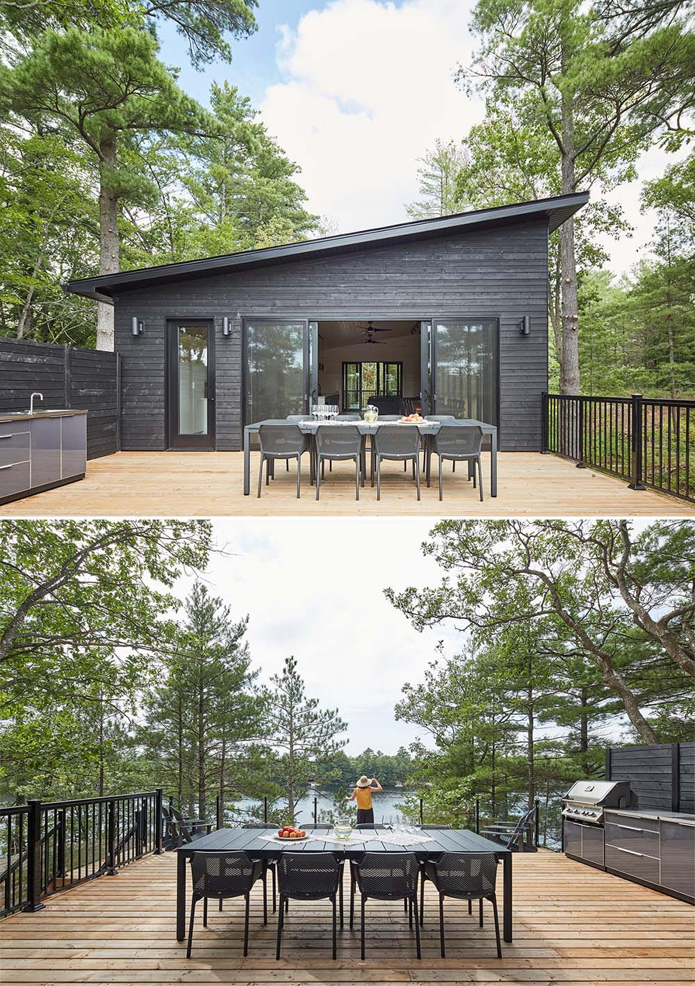 A modern black cottage with a deck furnished with an outdoor kitchen and a dining area.