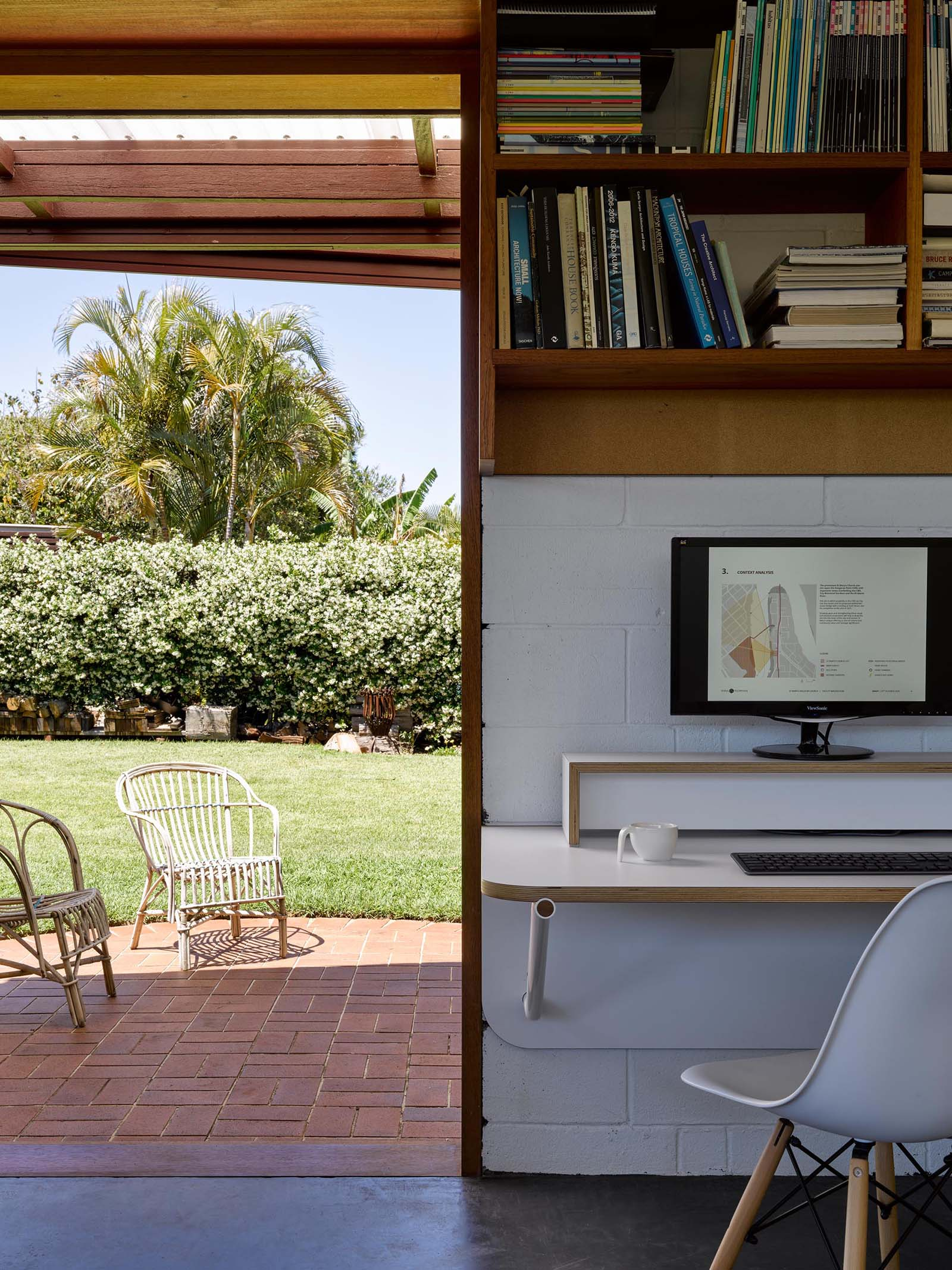 A backyard home office with a brick patio.