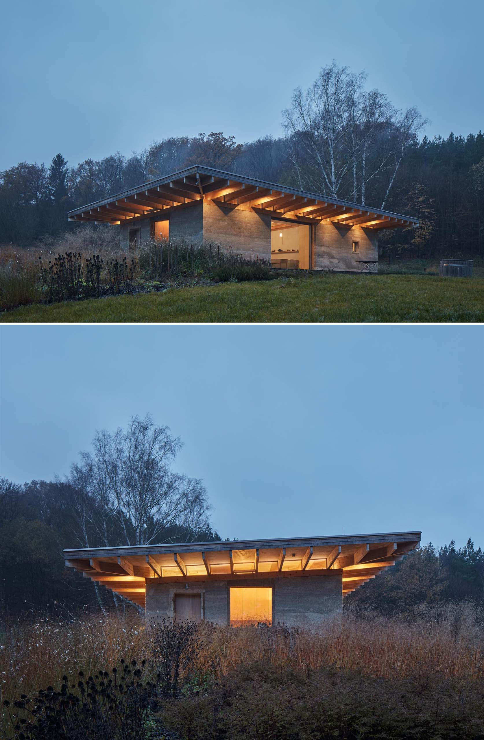 A modern cabin with a green roof and hempcrete walls is surrounded by nature.