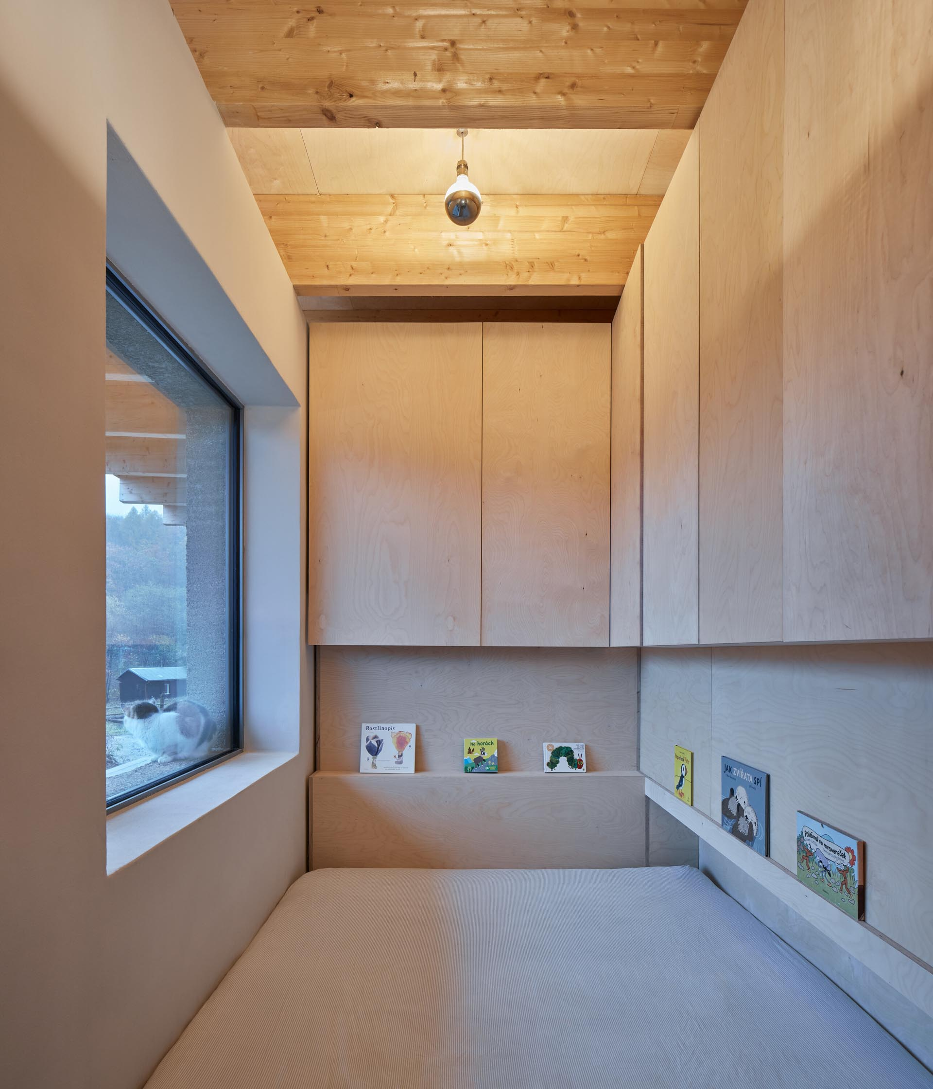 In this child's bedroom, there's a small wood ledge for holding books.