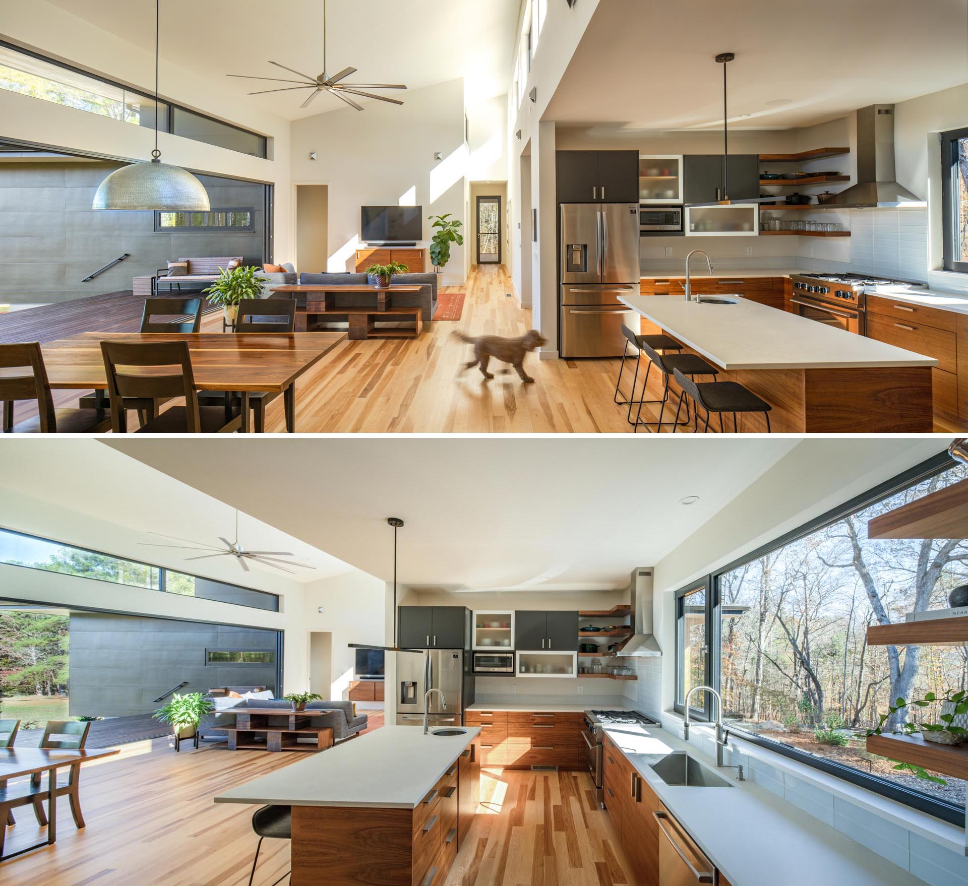 The kitchen in this modern home is adjacent to the living room and dining room, and includes an island with wood cabinetry and white countertops.