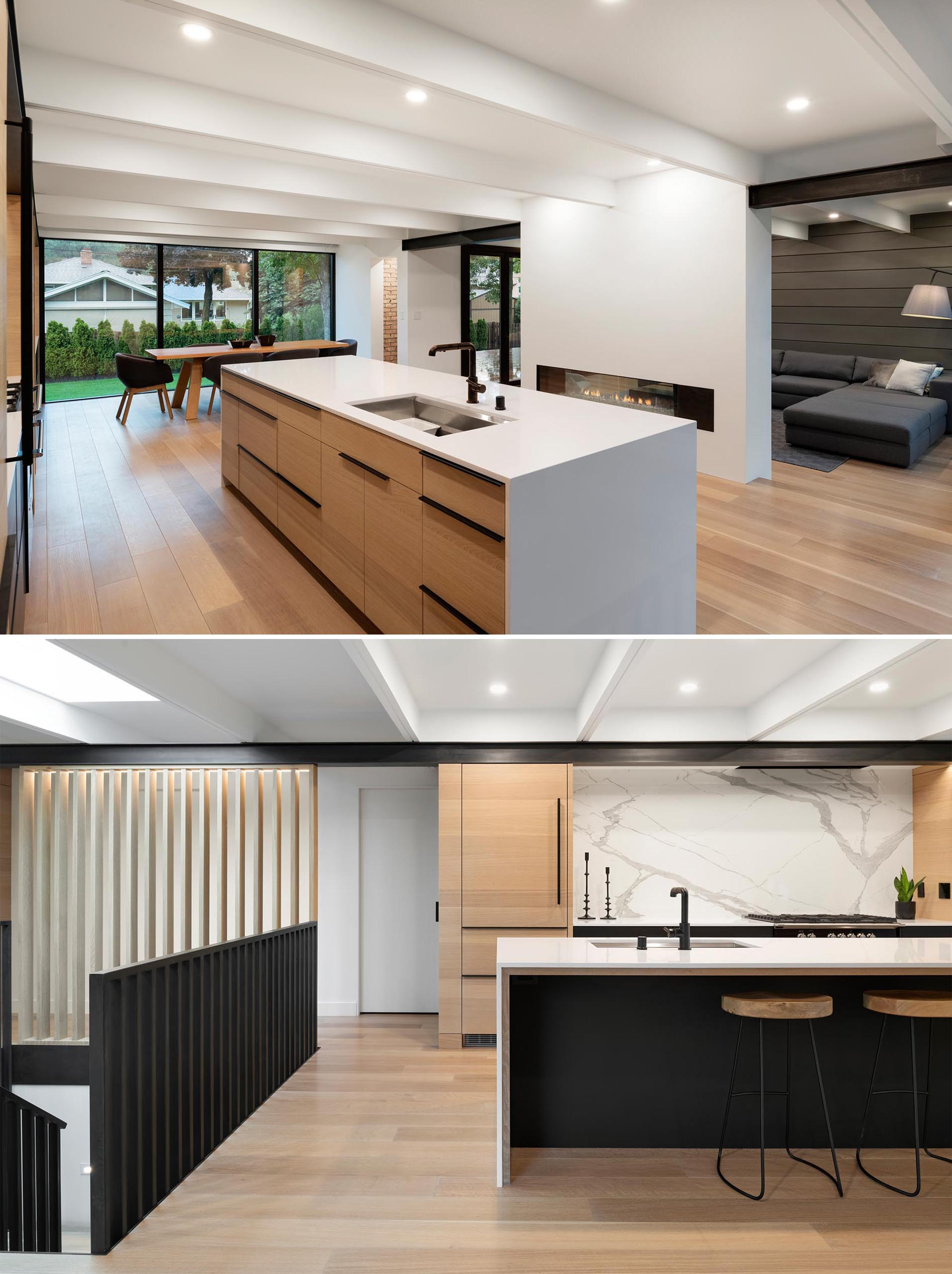 Wood kitchen cabinets are accented by minimalist black hardware and white countertops.