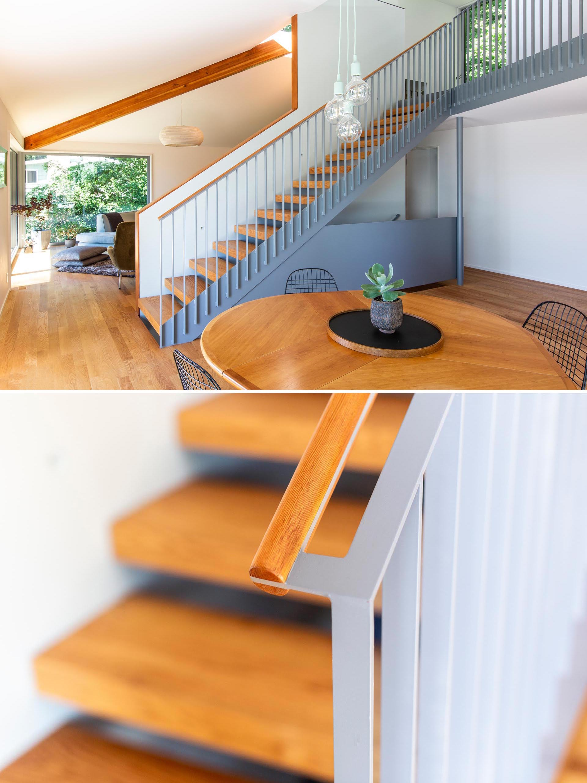 Matte gray and wood stairs connect the main level of this modern home with the upper floor.
