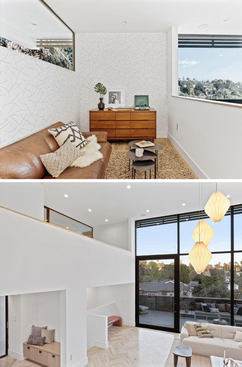 This modern house has a small loft area that overlooks the living room below. #Loft #InteriorDesign