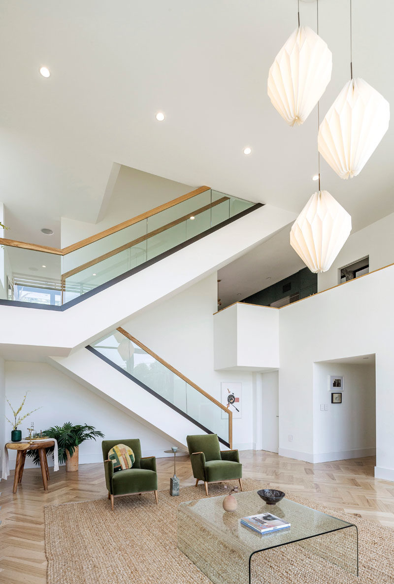 Stair Ideas - This modern house has a large staircase with glass and wood handrails. #Stairs #StairIdeas #ModernStairs
