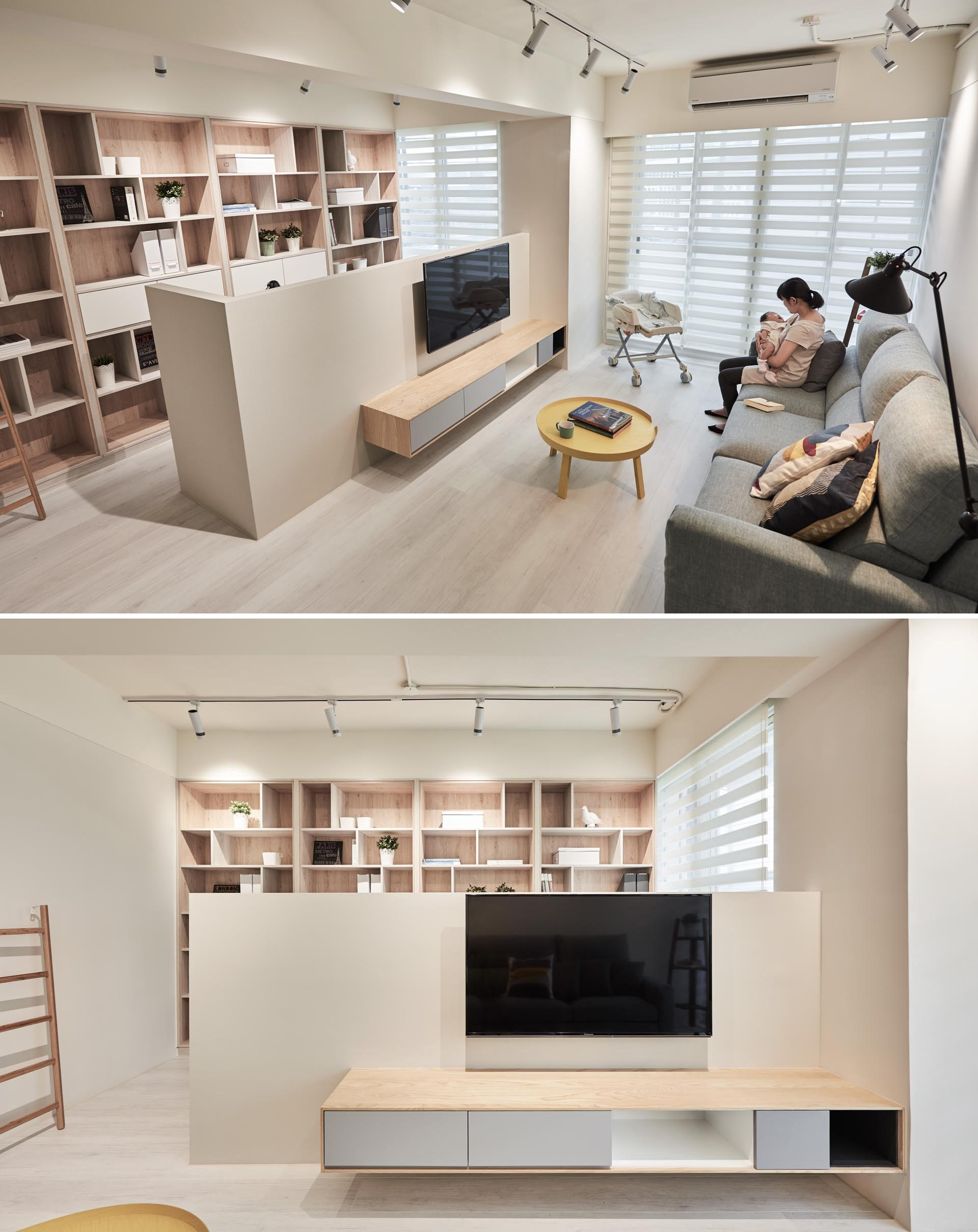 A low partition wall creates a space for a home office in this apartment living room.