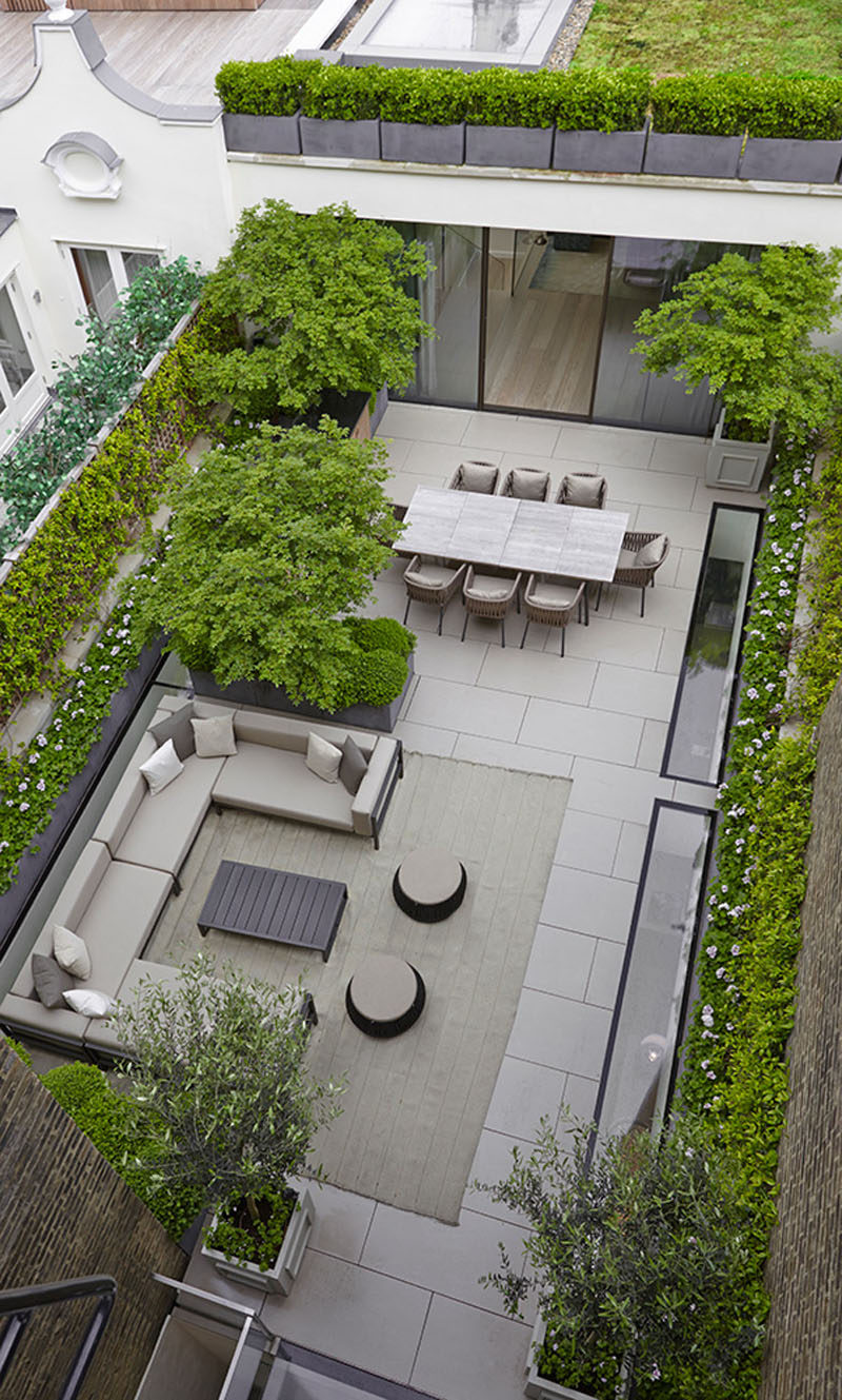 16 Inspirational Backyard Landscape Designs As Seen From Above // This space is more a patio than a backyard but the basic principles still apply - there's an outdoor dining area and a place for catching up on the couch. #Backyard #YardIdeas #LandscapingIdeas #YardLayout #YardDesign