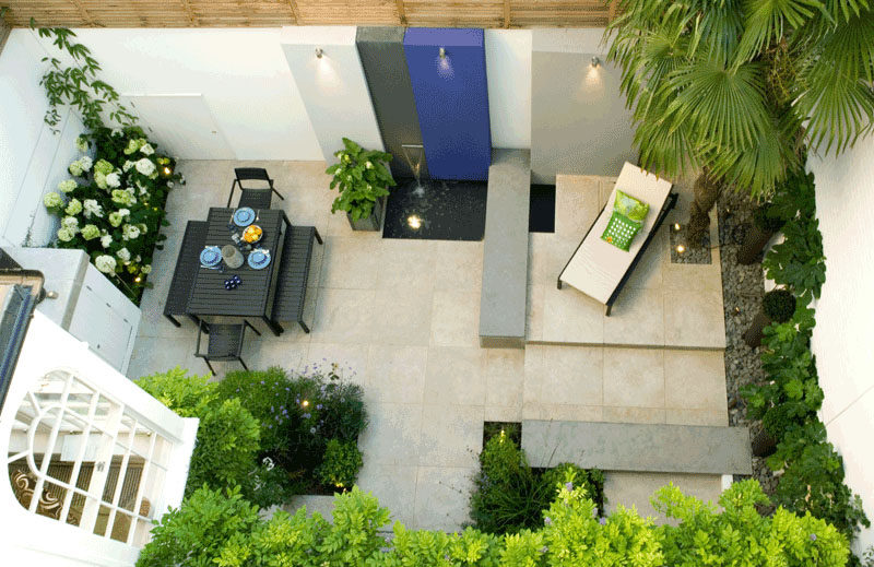 16 Inspirational Backyard Landscape Designs As Seen From Above // More patio-like than backyard-like, this space with a water feature, still offers a relaxing place to gather or enjoy the sun solo. #Backyard #YardIdeas #LandscapingIdeas #YardLayout #YardDesign