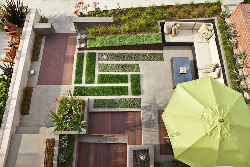 16 Inspirational Backyard Landscape Designs As Seen From Above // This back patio has added lots of greenery and clean lines to keep it modern, but also keep it feeling like a natural, outdoor space. #Backyard #YardIdeas #LandscapingIdeas #YardLayout #YardDesign