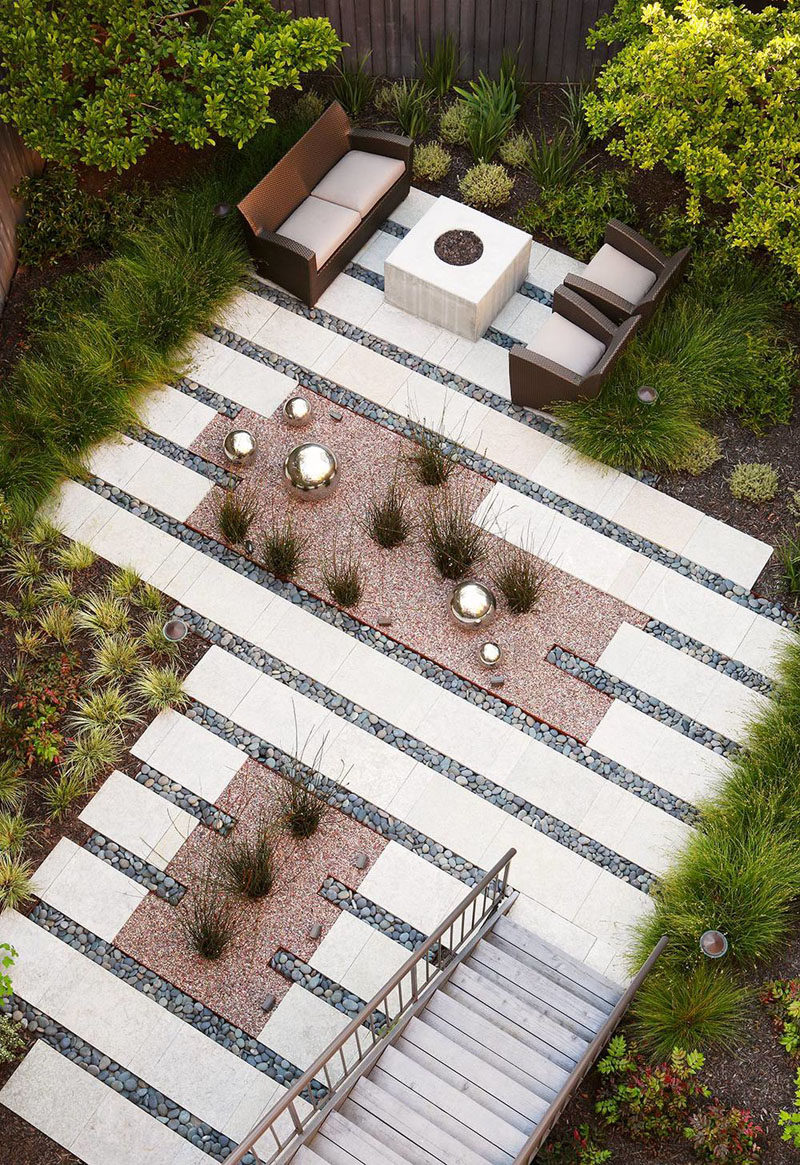 16 Inspirational Backyard Landscape Designs As Seen From Above // This backyard oasis might lack traditional grass but the planted grasses, ferns, and trees still make it feel like a proper backyard. #Backyard #YardIdeas #LandscapingIdeas #YardLayout #YardDesign