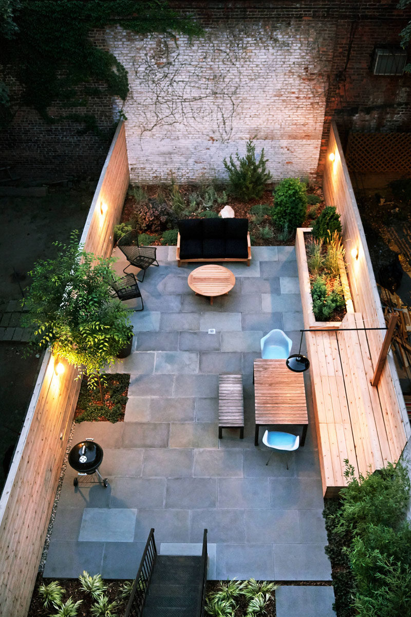 16 Inspirational Backyard Landscape Designs As Seen From Above // Entertaining can go late into the night with the built in lighting on this back patio. #Backyard #YardIdeas #LandscapingIdeas #YardLayout #YardDesign
