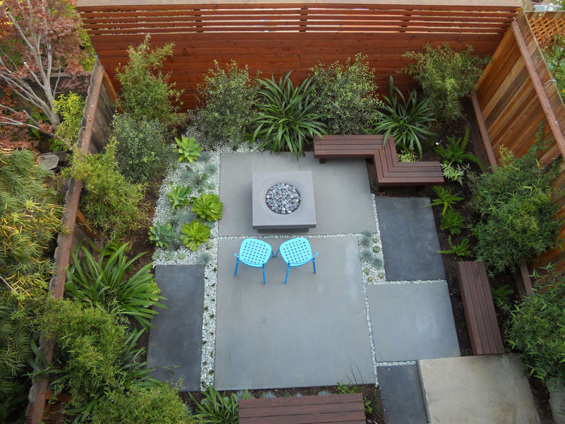 16 Inspirational Backyard Landscape Designs As Seen From Above // Here's a contemporary patio with a mix of low maintenance plants and seating around a fire pit. #Backyard #YardIdeas #LandscapingIdeas #YardLayout #YardDesign