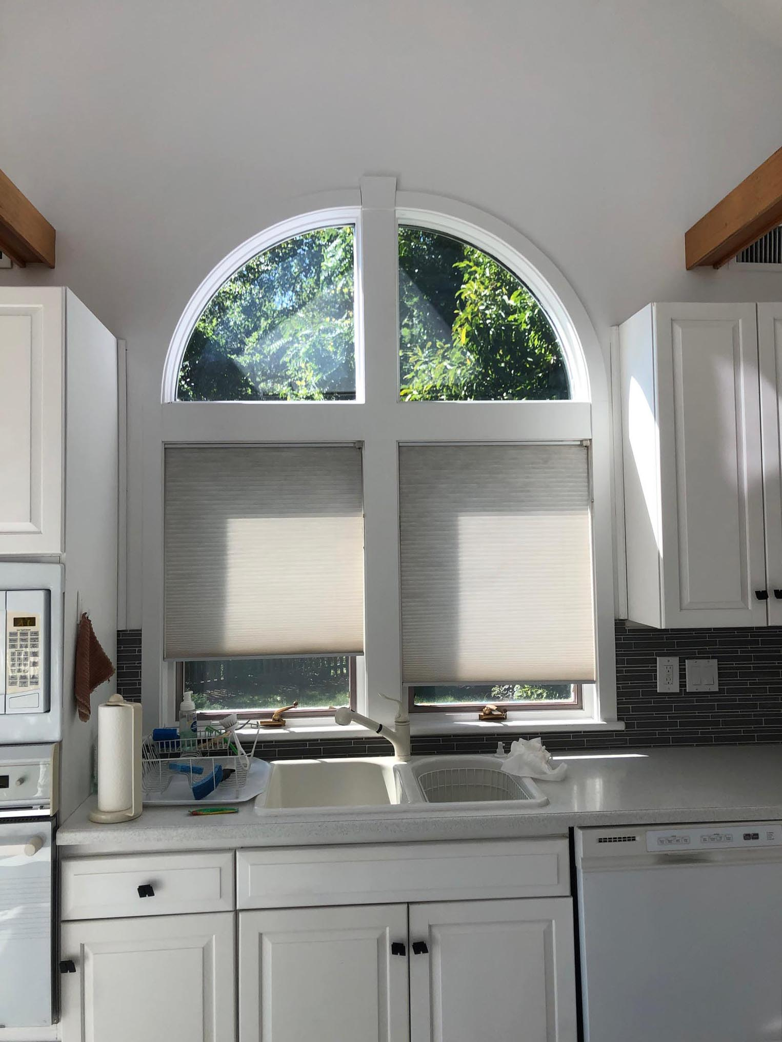 This original 1980s kitchen was outdated with old appliances and an uniquely shaped island. It was remodeled and transformed into a contemporary kitchen.