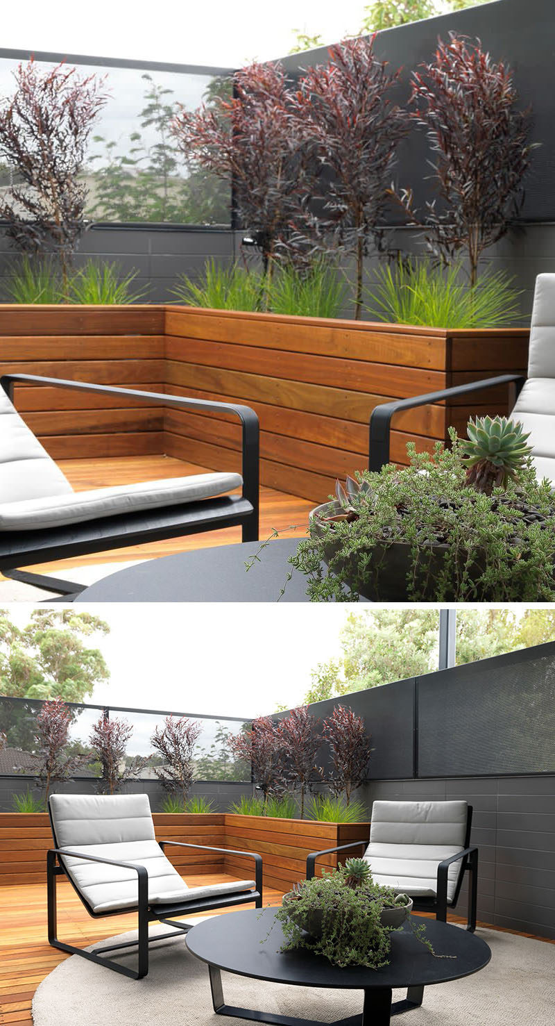 12 Ideas For Including Built-In Wooden Planters In Your Outdoor Space // These large wood planters create a space for greenery, and as the plants grow, will contribute to making the patio more private as well. #WoodPlanters #BuiltInPlanters #Landscaping #LandscapeDesign #BackyardPlanters #YardIdeas