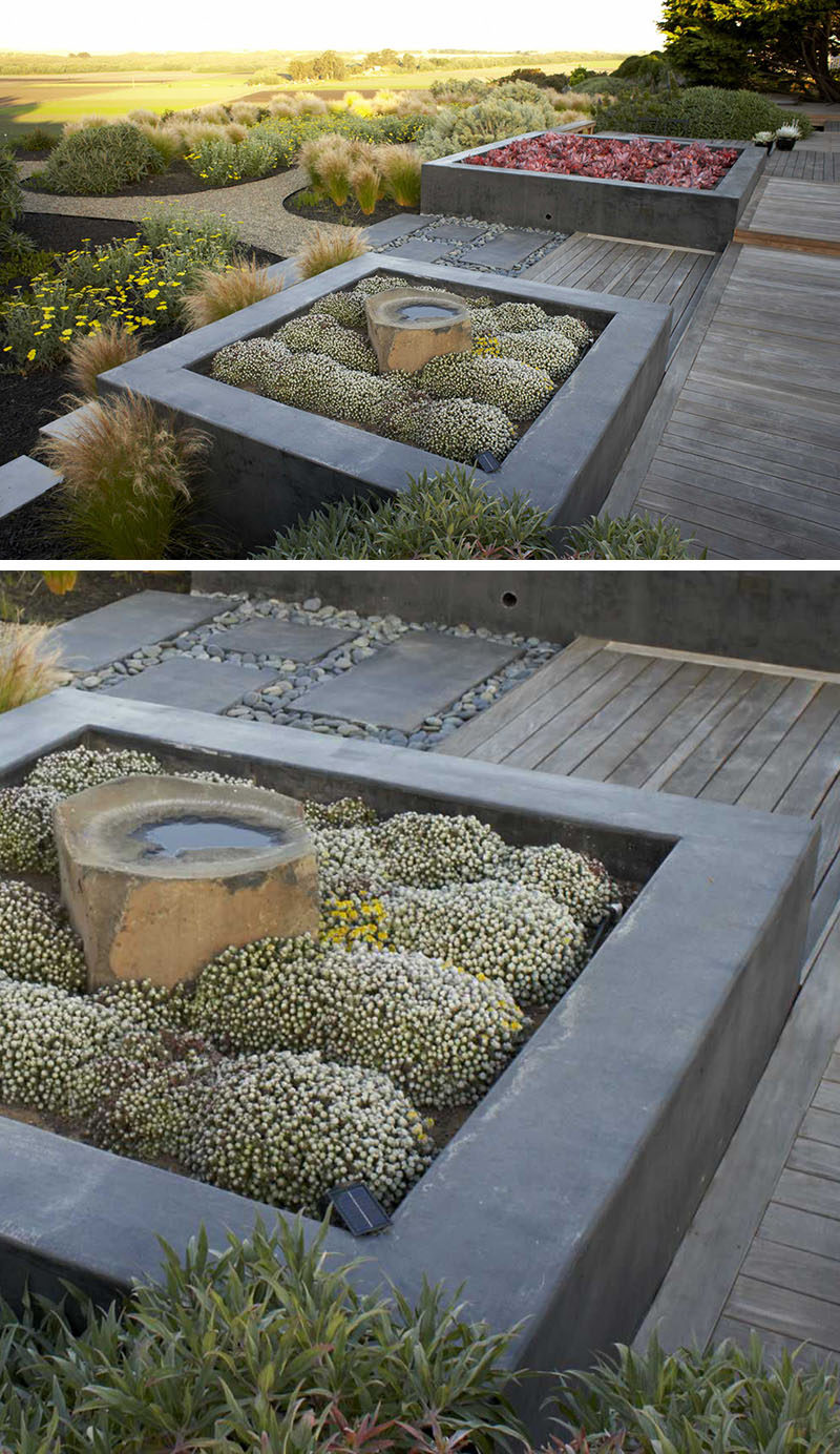 10 Inspirational Ideas For Including Custom Concrete Planters In Your Yard // Custom concrete planters were designed for this garden, and the designers have paired them with Ipe decking to create a contemporary look.