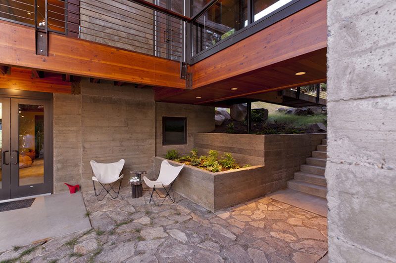 10 Inspirational Ideas For Including Custom Concrete Planters In Your Yard // These concrete planters at a home in North Idaho, have been made from poured-in-place board-form concrete.