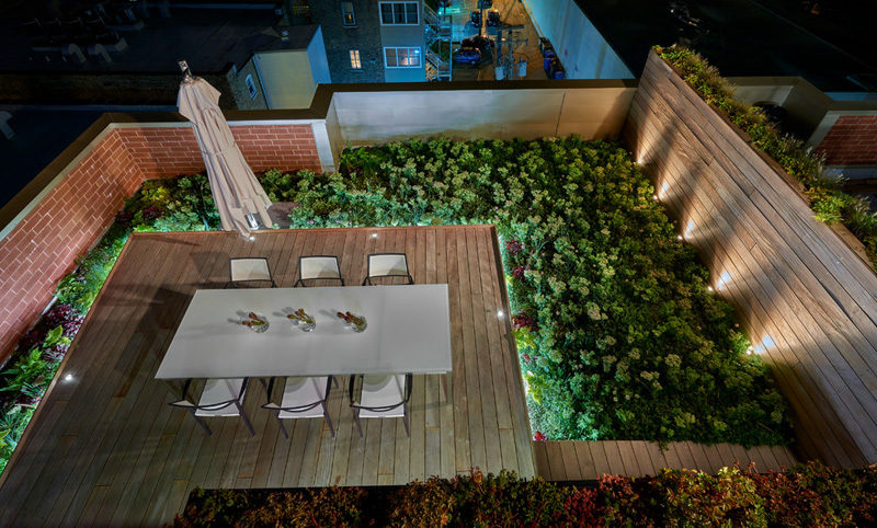7 Design Lessons To Learn From This Awesome Roof Deck In Chicago // Include lots of plants -- Whether they can be planted into a garden bed or in pots, plants help to create a feeling of nature and not a concrete jungle.