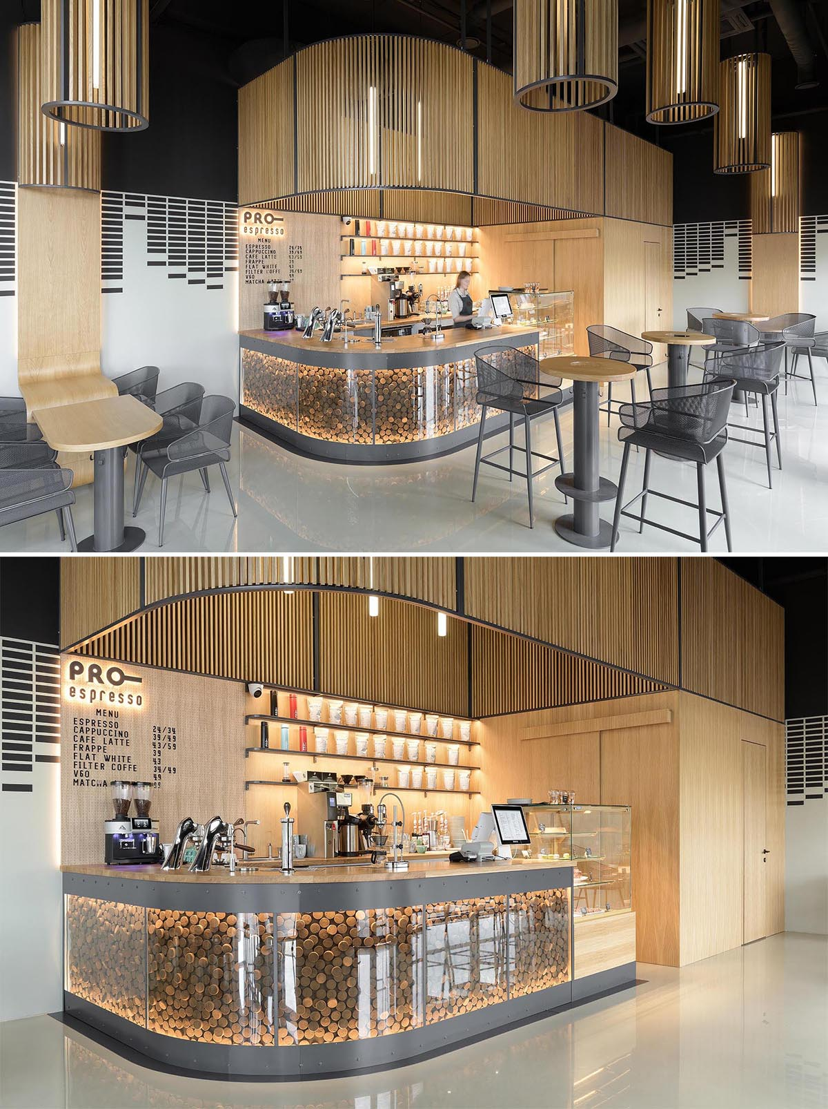 A service bar showcases the coffee machines, while the curved design complements the table designs and the column shaped lights hanging from the ceiling.