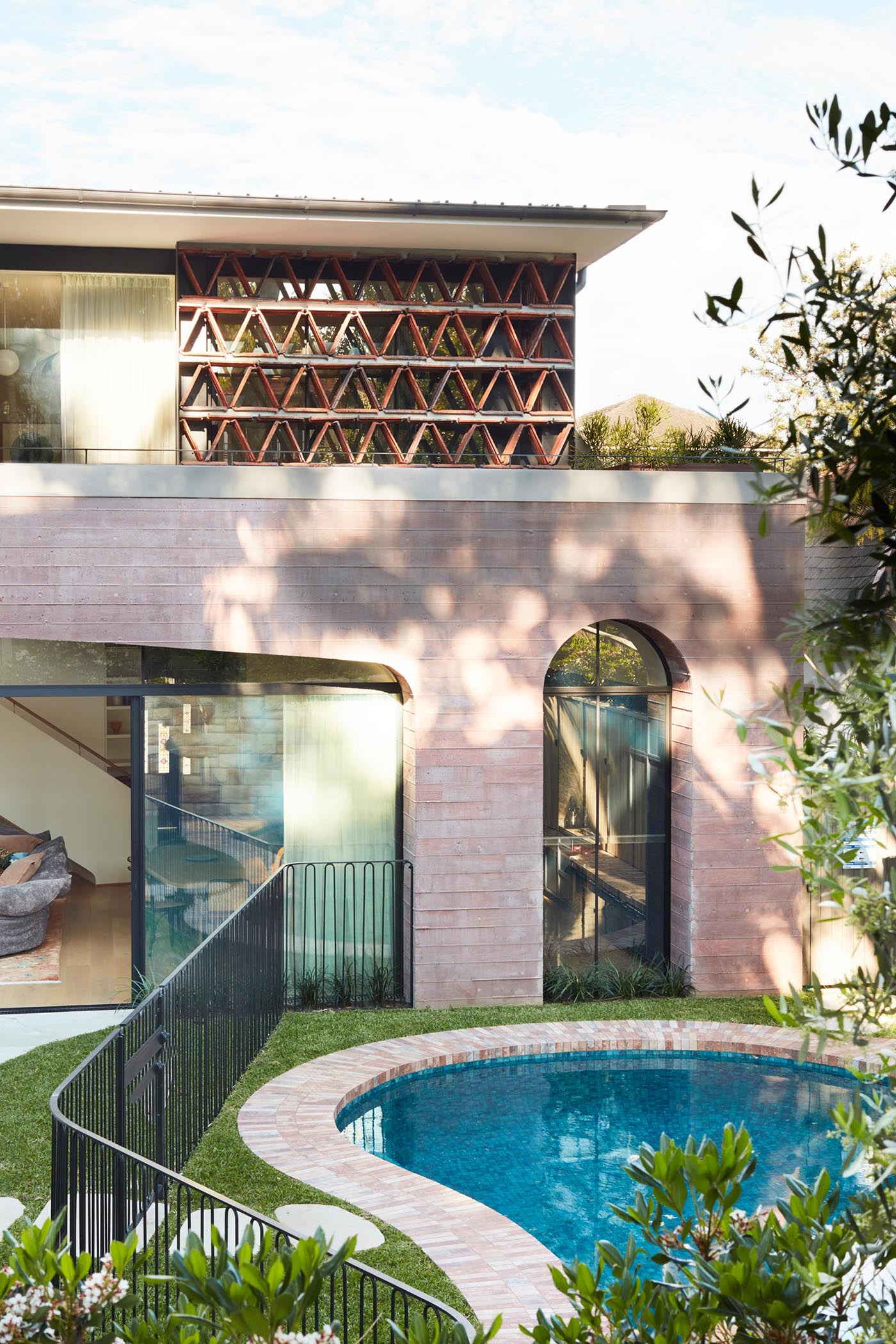 A modern home extension made from pink concrete.