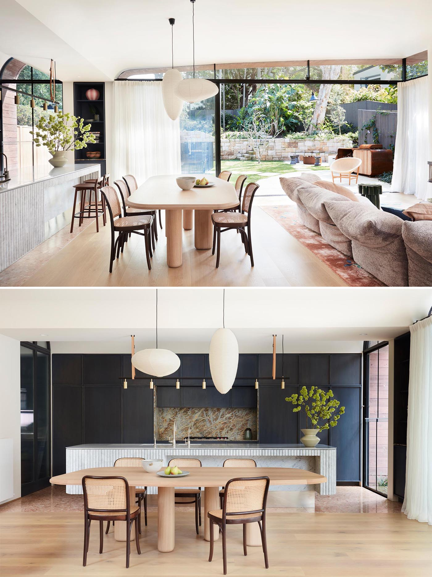 This dining area is used to separate the living room and kitchen, and is anchored by two pendant lights.