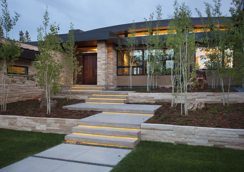 7 Landscaping Ideas For Your Front Yard // Include lighting --- A lit pathway or lights tucked into the garden helps your house stand out at night, and makes it safer for people leaving after dark.
