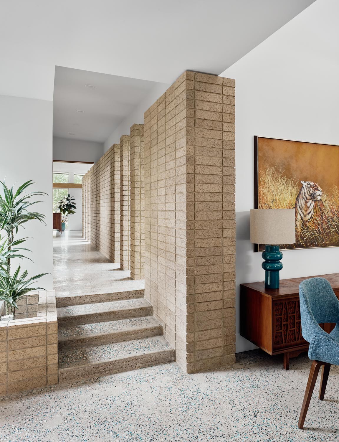 Throughout this mid-century modern inspired home, 1800 pounds (816kg) of various colored glass was hand spread into the concrete floor as it was setting up, making a one-of-a-kind unique floor.