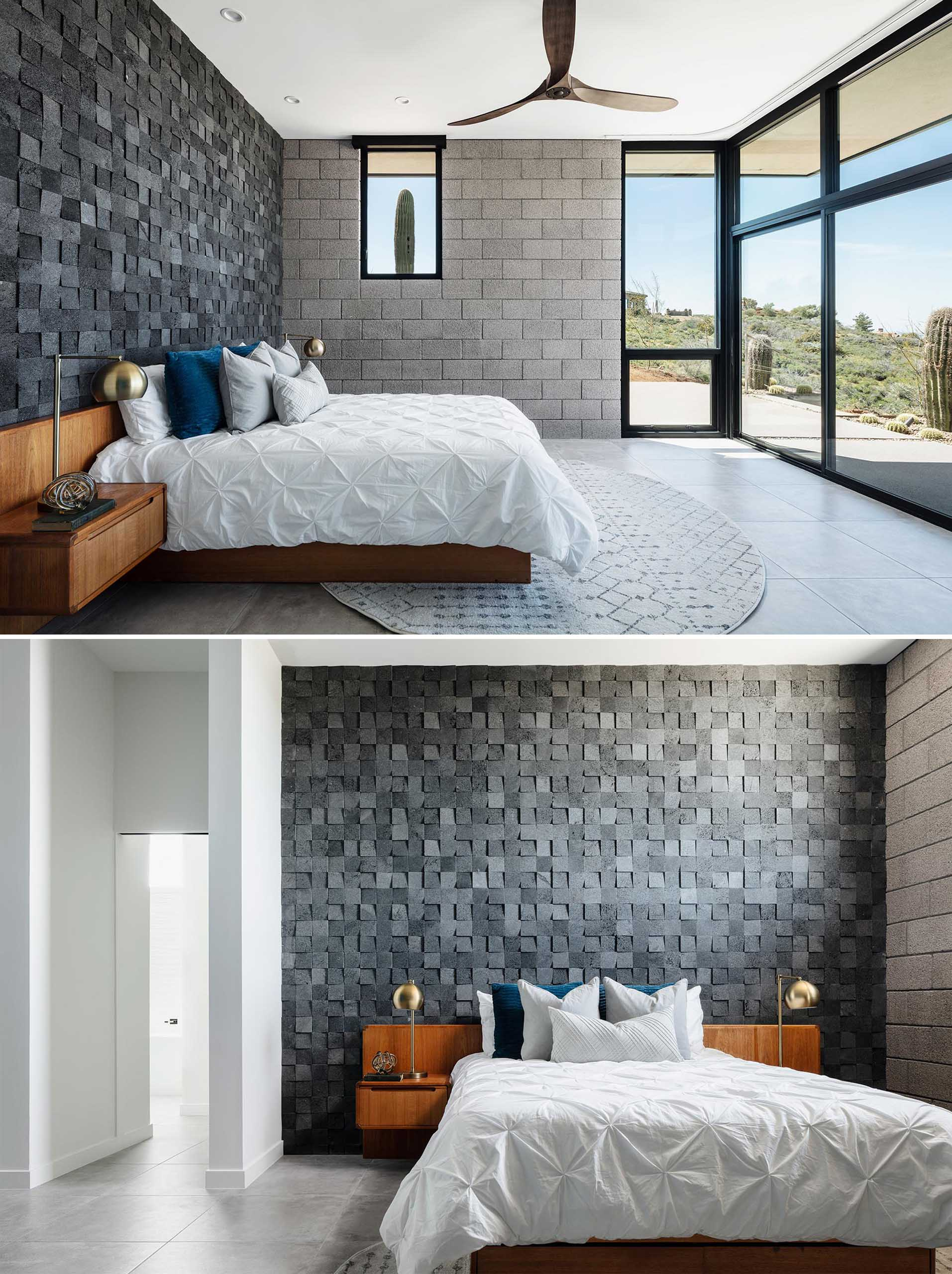 This modern master bedroom suite has views to the desert beyond through the large windows, while the accent wall is made from 3d lava rock tile.