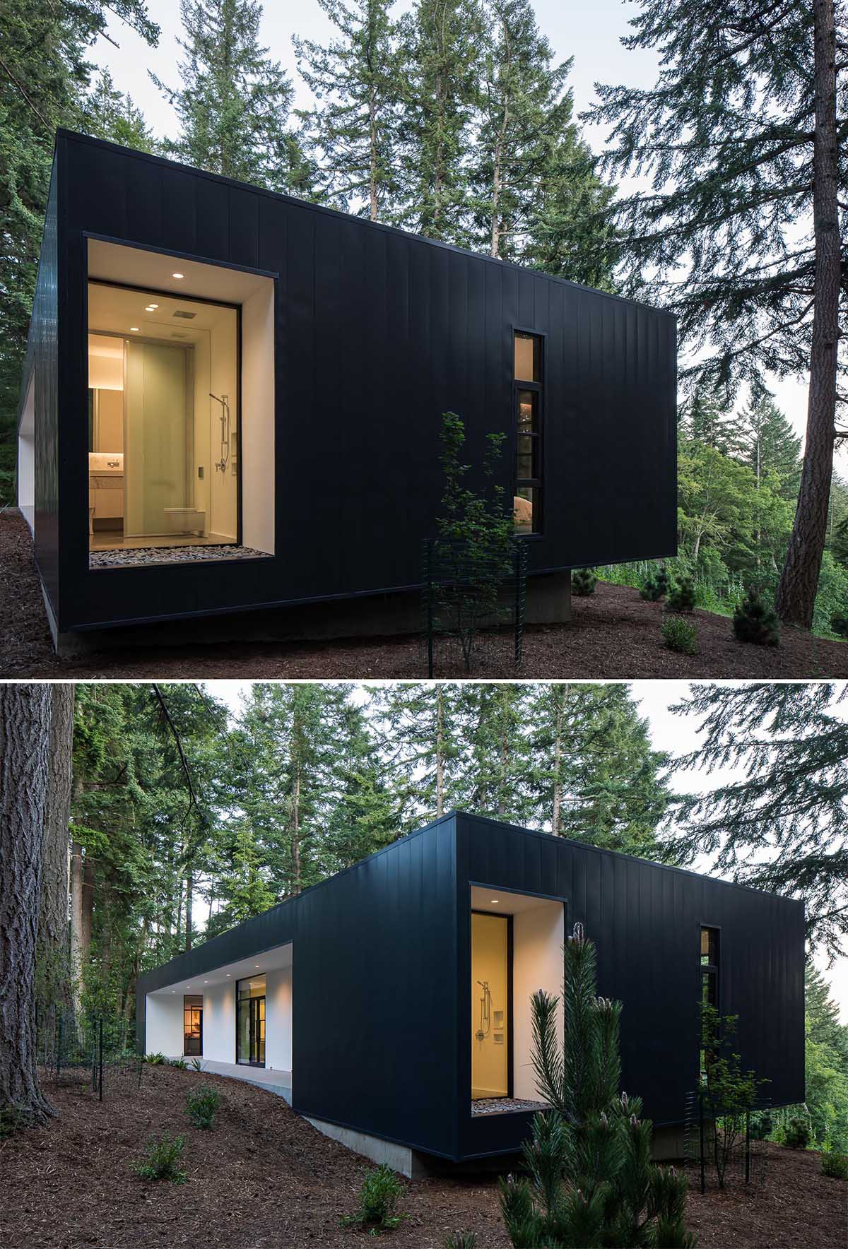 A small and modern home with white stucco and black metal panels on the exterior.
