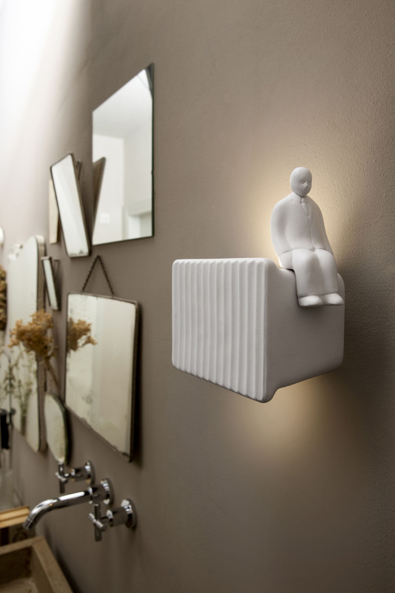 Italian lighting company KARMAN, has released Umarell, a fun wall lamp that was inspired by a familiar sight in Bologna, a man watching work being done on a building site. #WallLamp #Lighting #Design