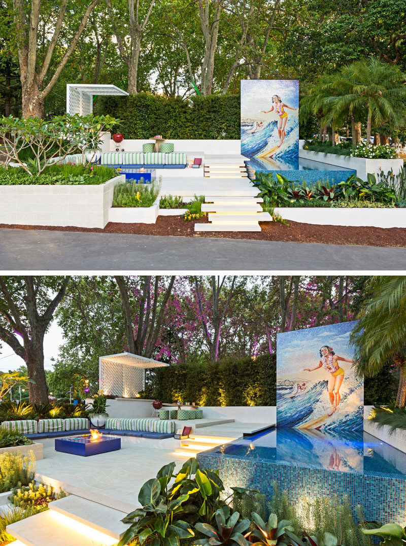 Inspired by the Hawaiian word Ohana, meaning 'Family', this modern garden sets out to portray a relaxing family space, specifically geared to the family with teenage kids. It has a pool with a large mural, a dining area with outdoor kitchen, and a lounge area with a firetable. #Landscaping #GardenDesign #Pool #OutdoorDining #LandscapeDesign
