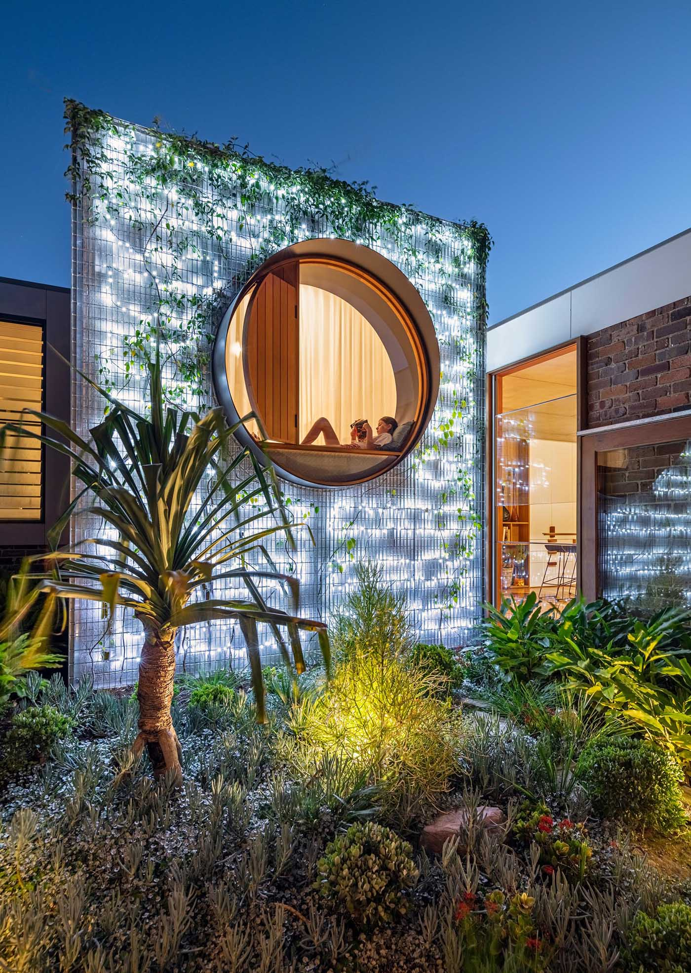 At night, this wall is lit from behind, creating an outdoor focal point that also helps to light up the nearby patio.