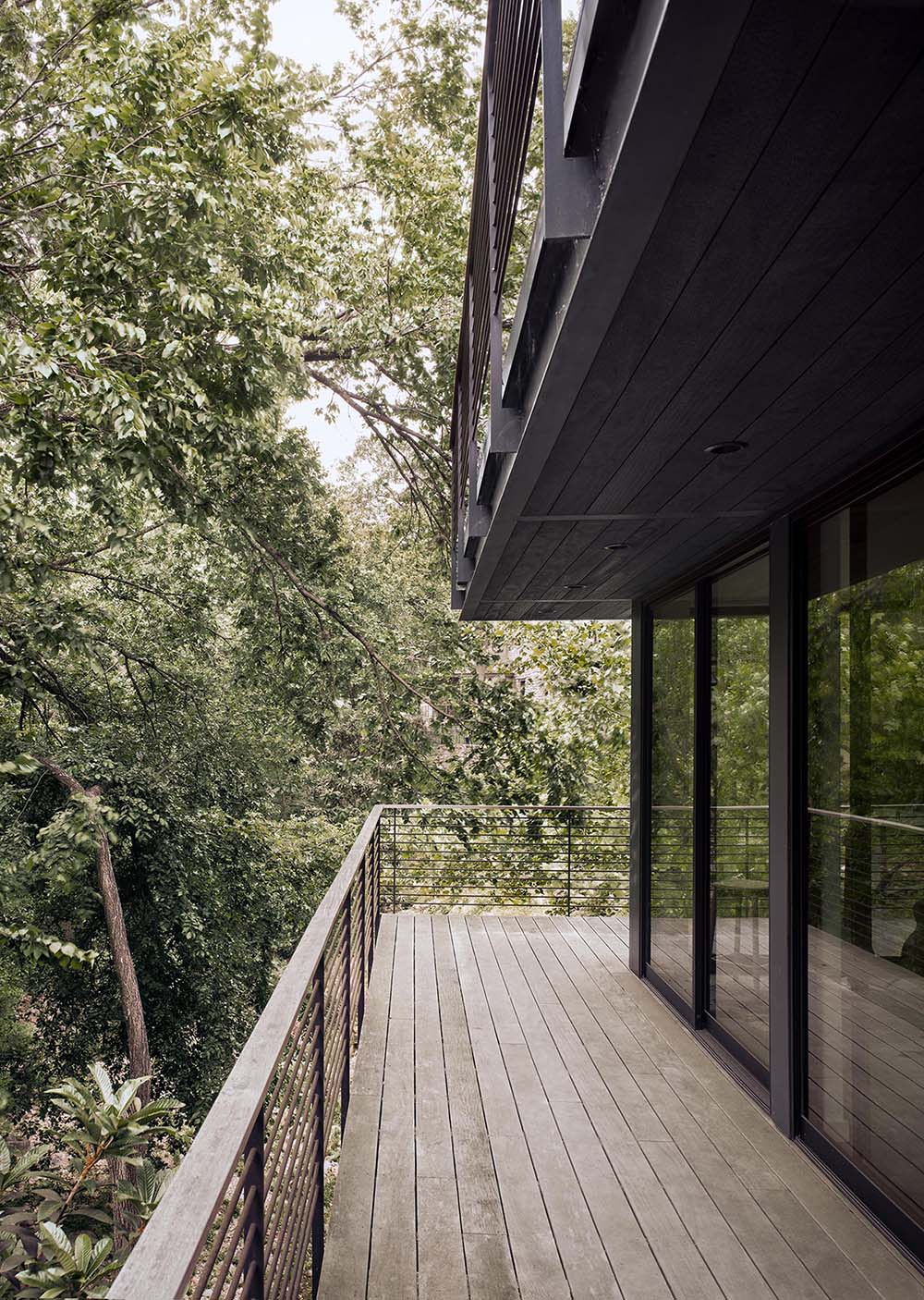 A wrap-around deck provides views of the trees, with a staircase the allows for easy access around the property.