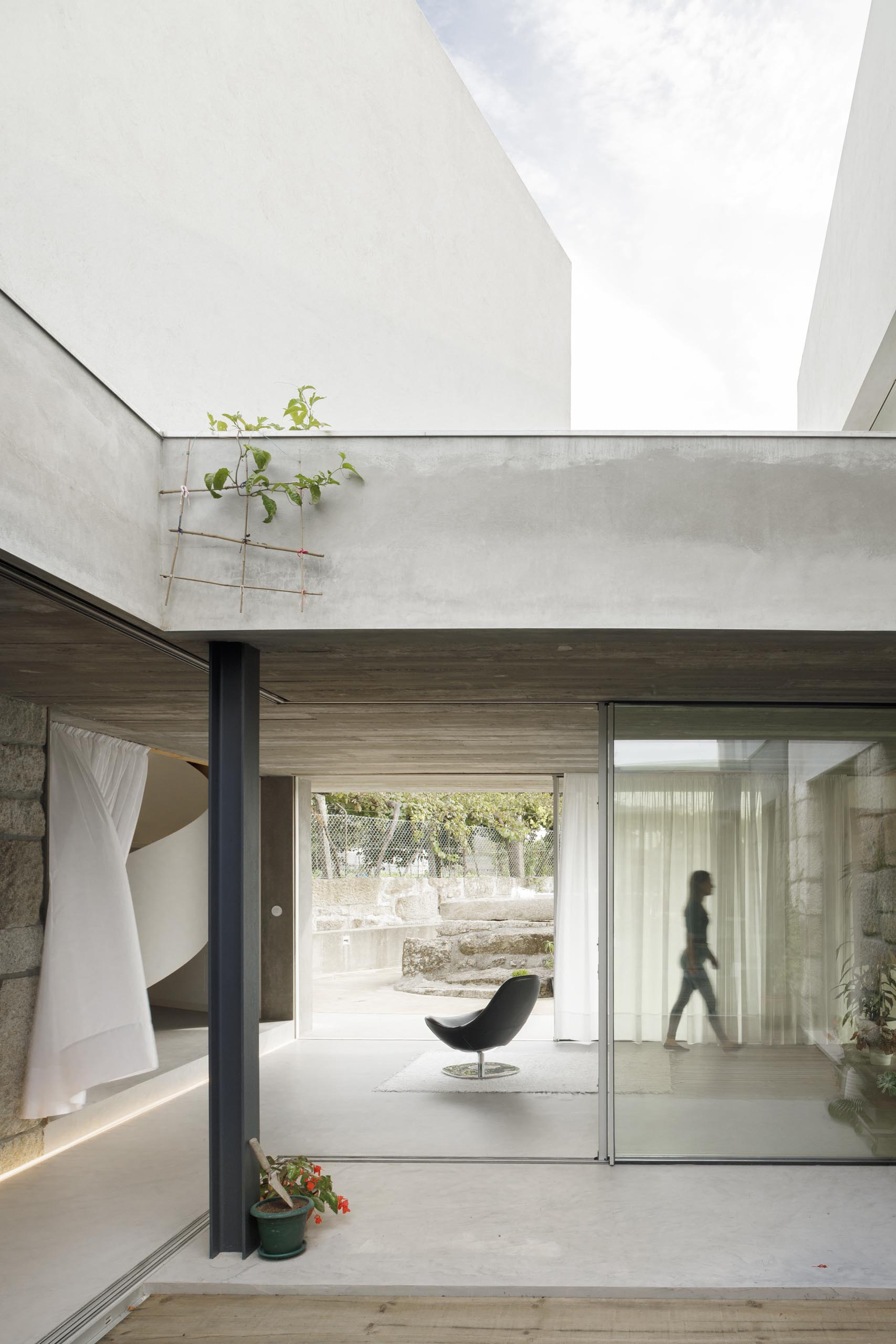 Sliding glass walls connect the interior areas of this home with the outdoors.