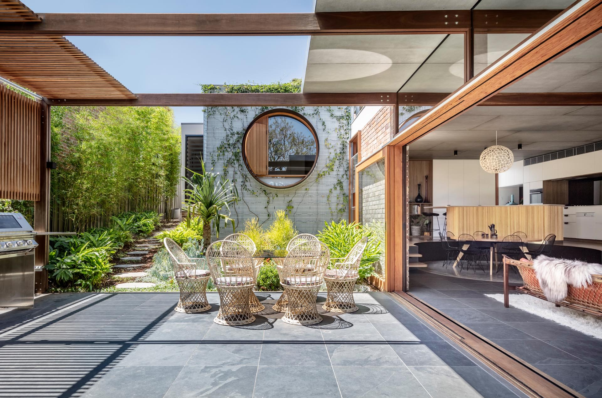 Indoor / outdoor living was key in the design of this modern addition, with a partially covered patio with a bbq area and outdoor dining.