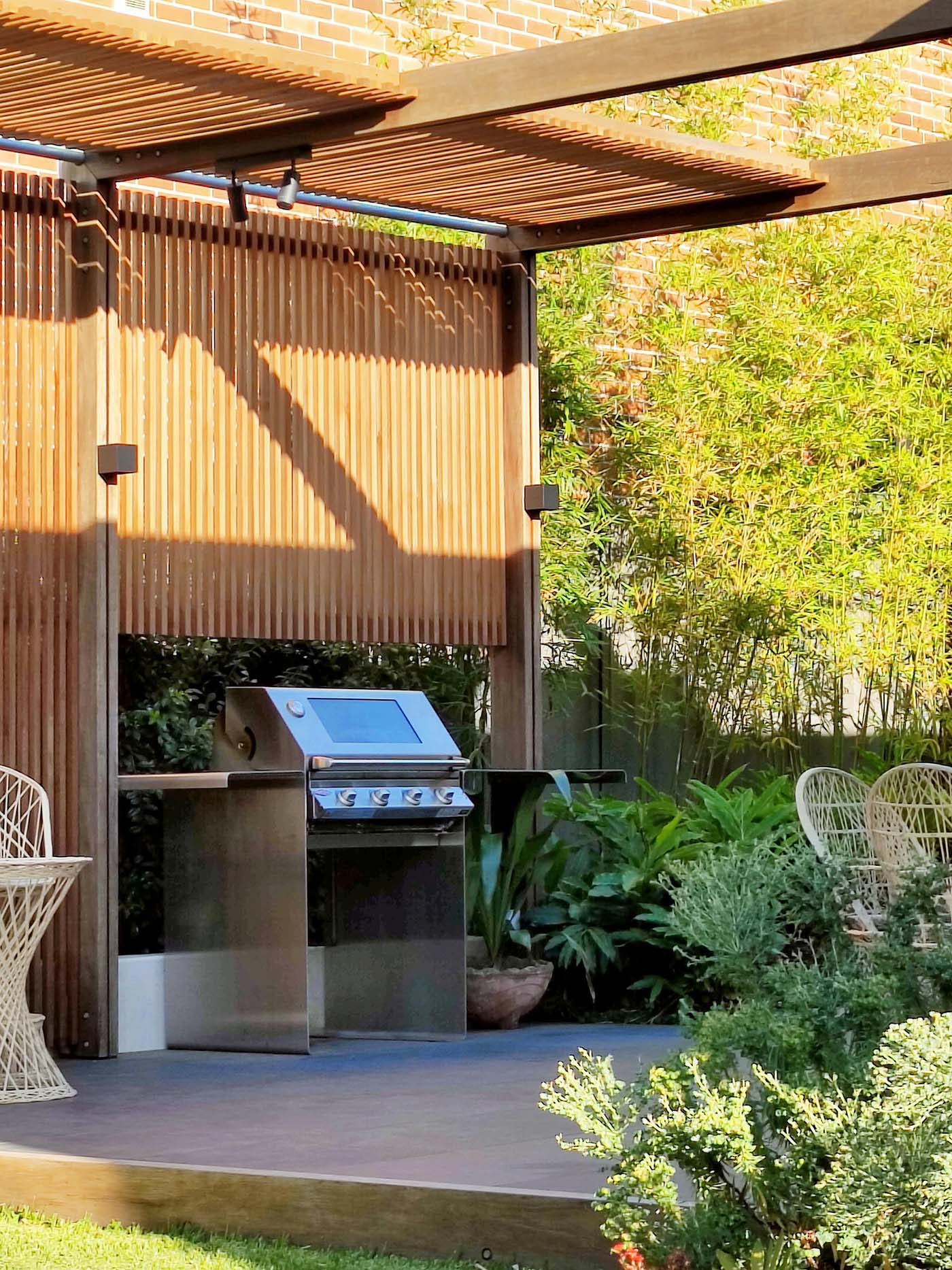 A modern partially covered outdoor bbq area.