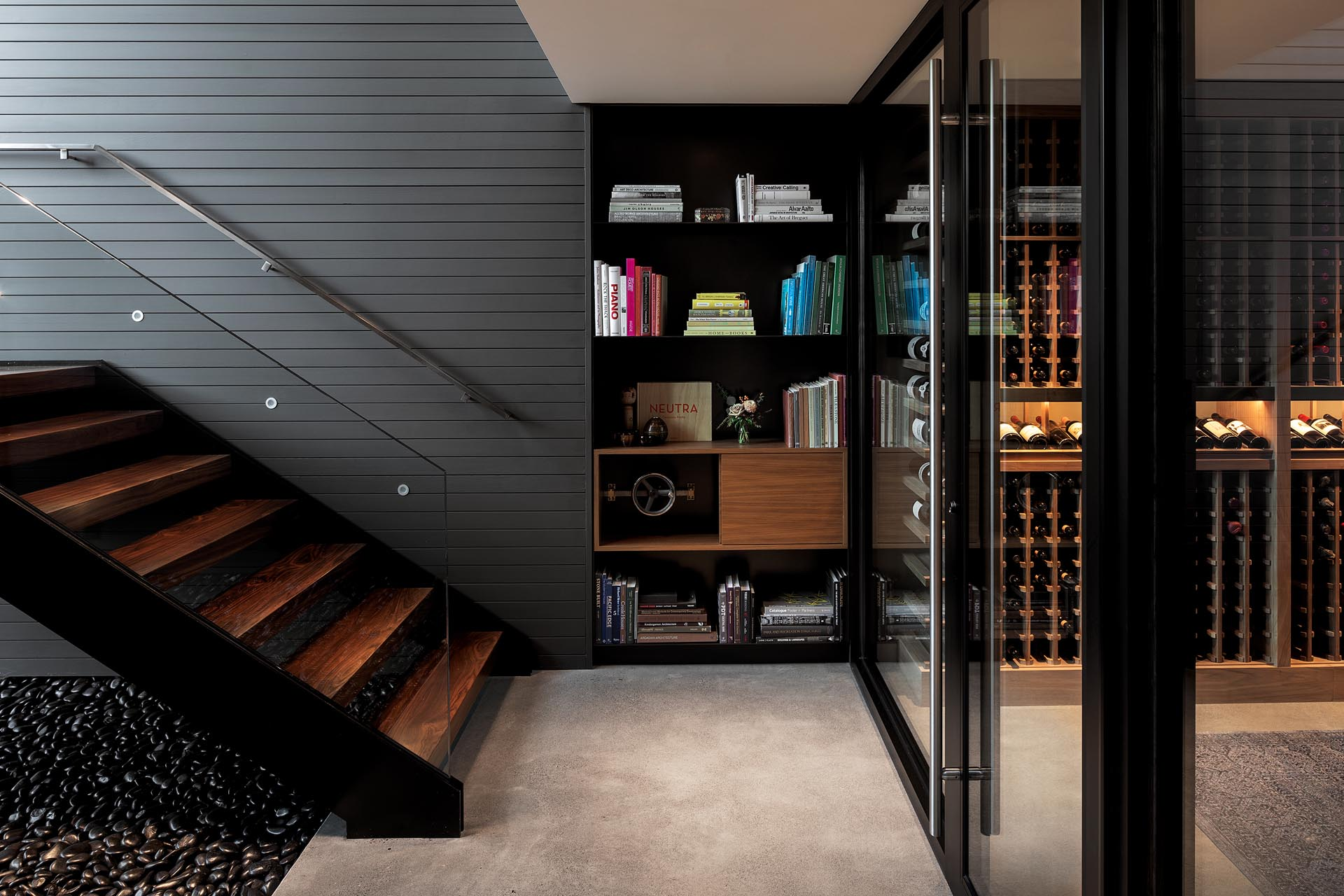This modern house has a hidden whiskey room - accessed through a secret latch in the bookshelf at the bottom of the stairs.