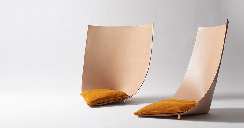 Jordi Ribaudí has designed a modern and sculptural chair, that's made from a single leather piece that backs back on itself to create the backrest, while small brass feet keep the structure together. #Design #Furniture #Chair #Seat #Leather