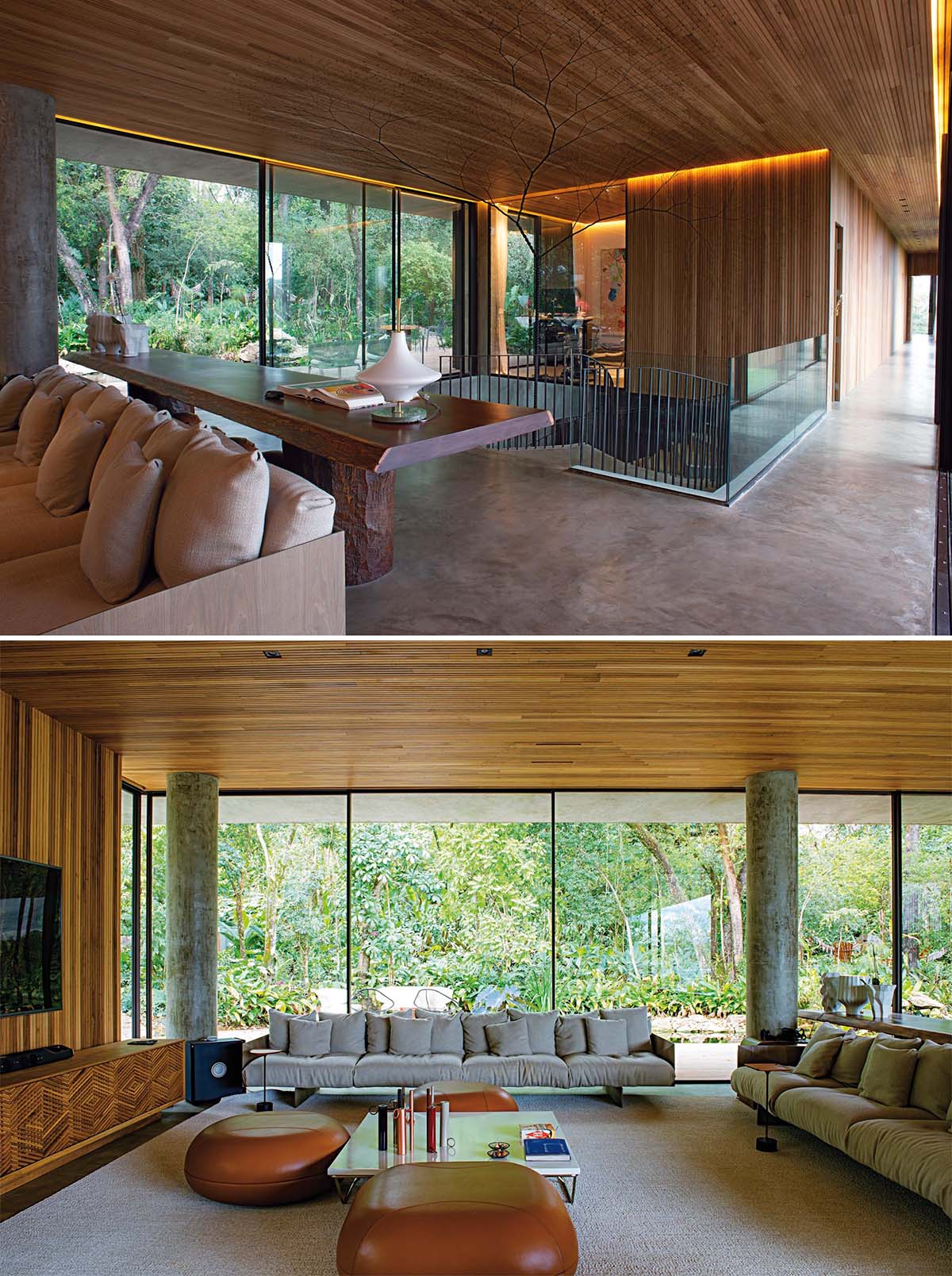 A wood ceiling and golden lighting adds a sense of warmth to this moderninterior, that also includes concrete floors, a hanging fireplace, and glass walls.