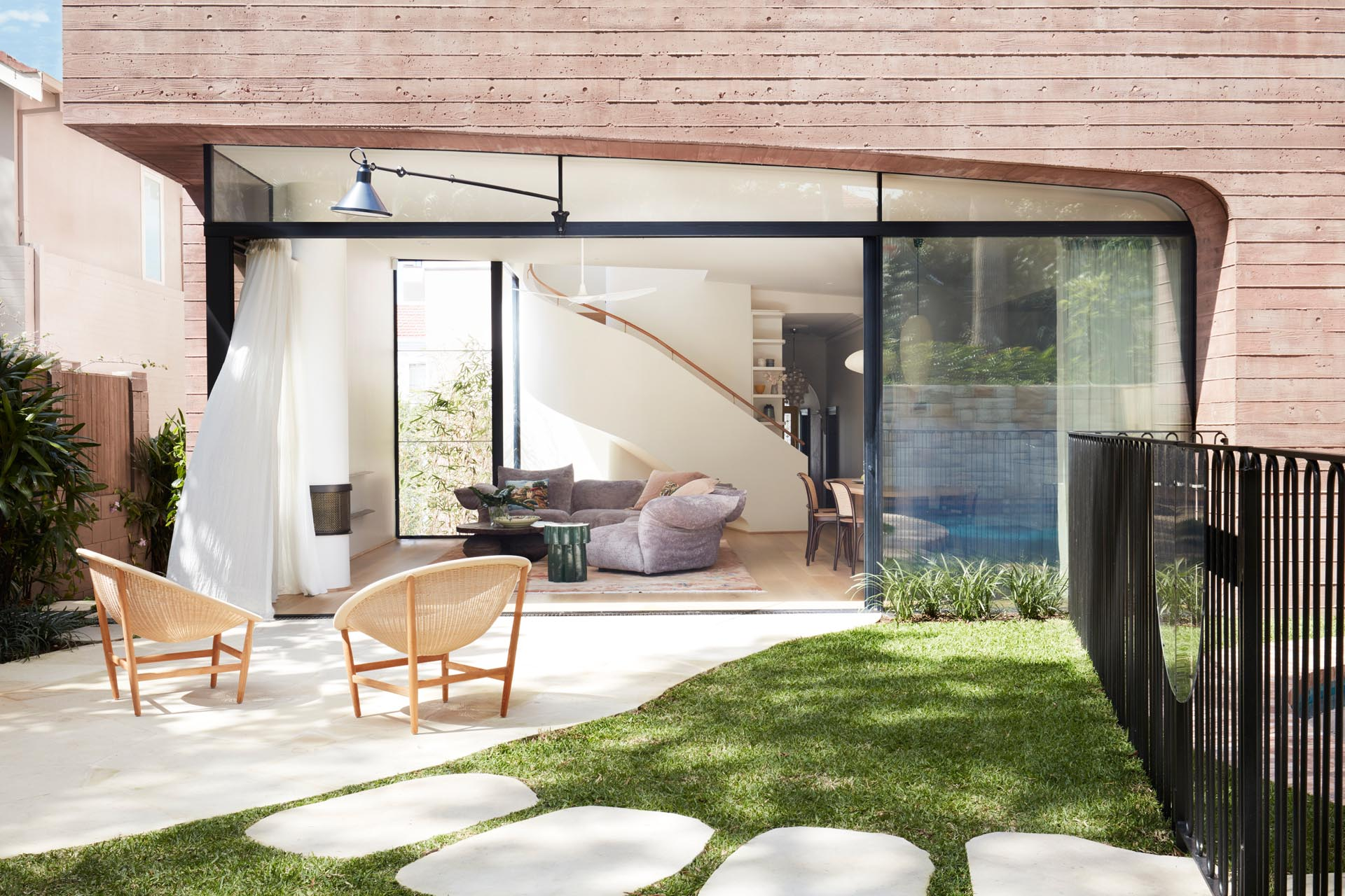 This simple patio is connected to the interior spaces by a large sliding glass door.