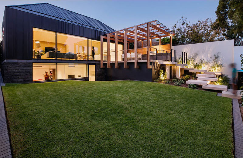 Architecture firm Glasshouse designed a family friendly backyard space with a number of design details like a modern pergola and entertaining deck, and a swimming pool.