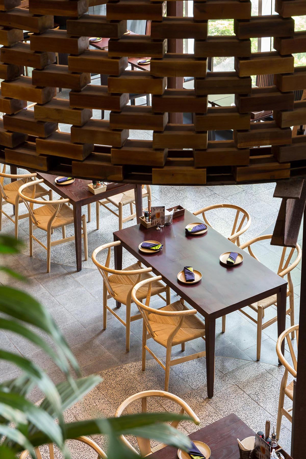 A contemporary restaurant with wood furniture.
