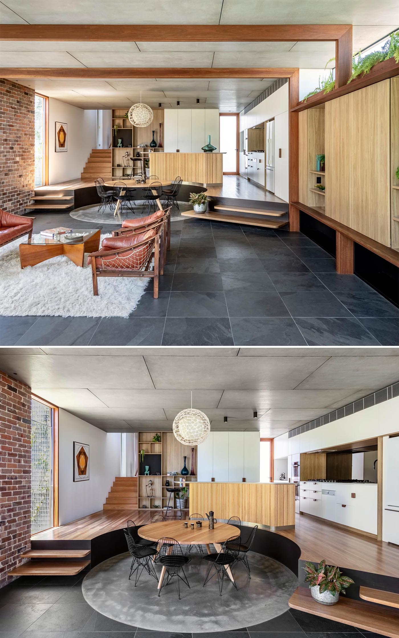 Behind the living room in this modern addition is the dining area, with a round wood table that sits upon a round rug.