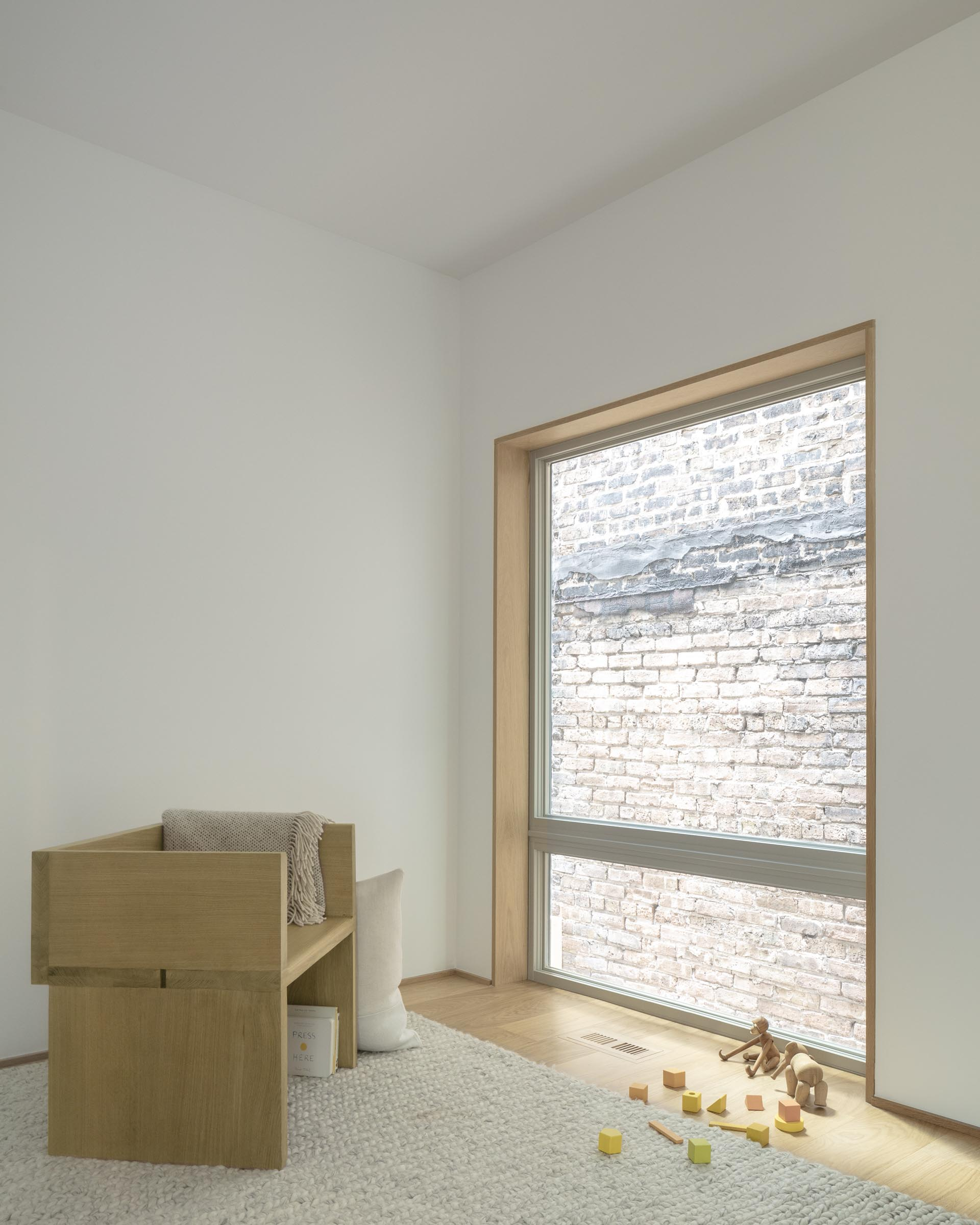 A modern white home interior with wood window frames.